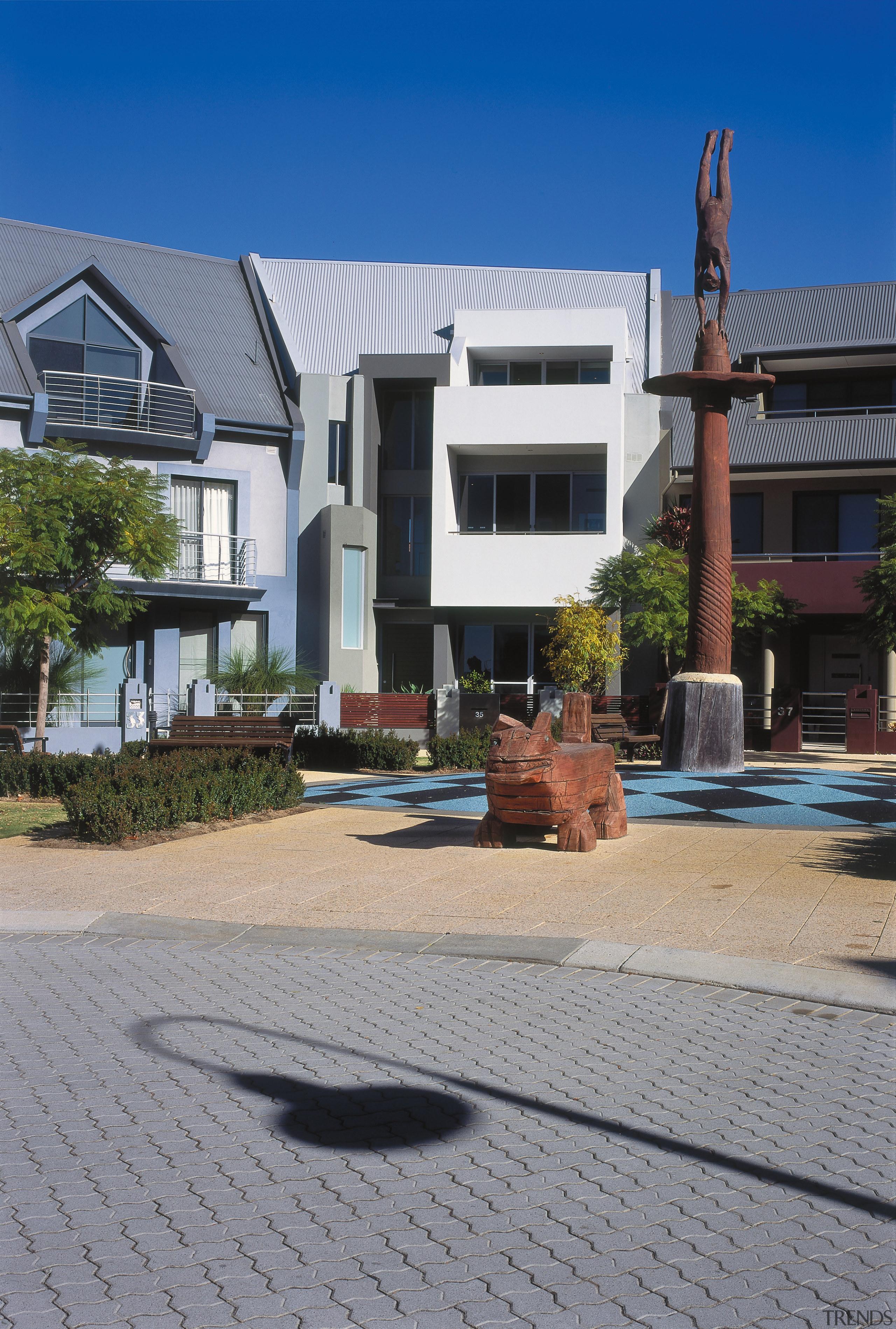 An exterior view of the home. - An building, estate, facade, home, house, neighbourhood, property, real estate, residential area, villa, gray