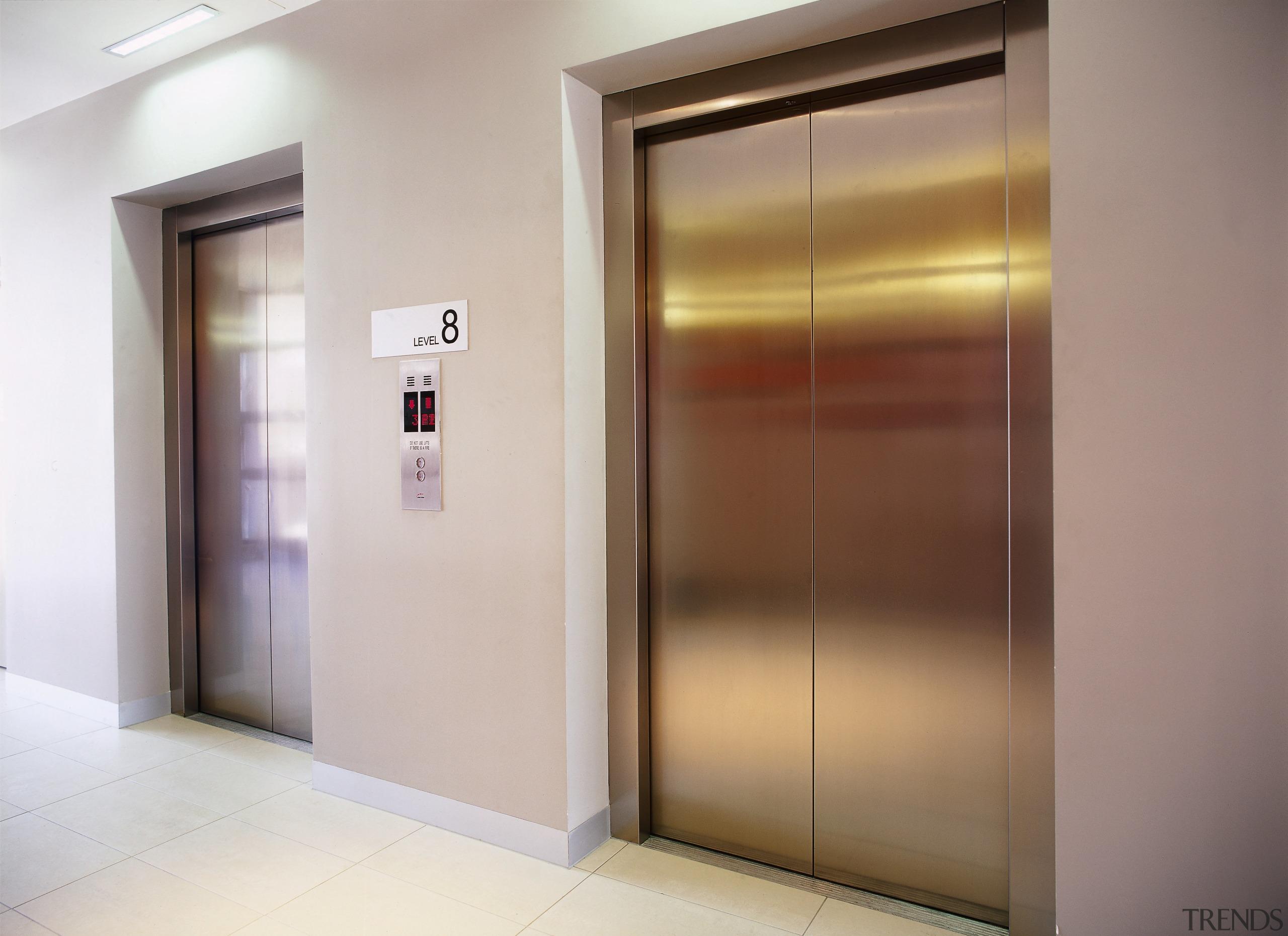 view of the large elevator form eastern elevators door, elevator, interior design, property, gray, brown