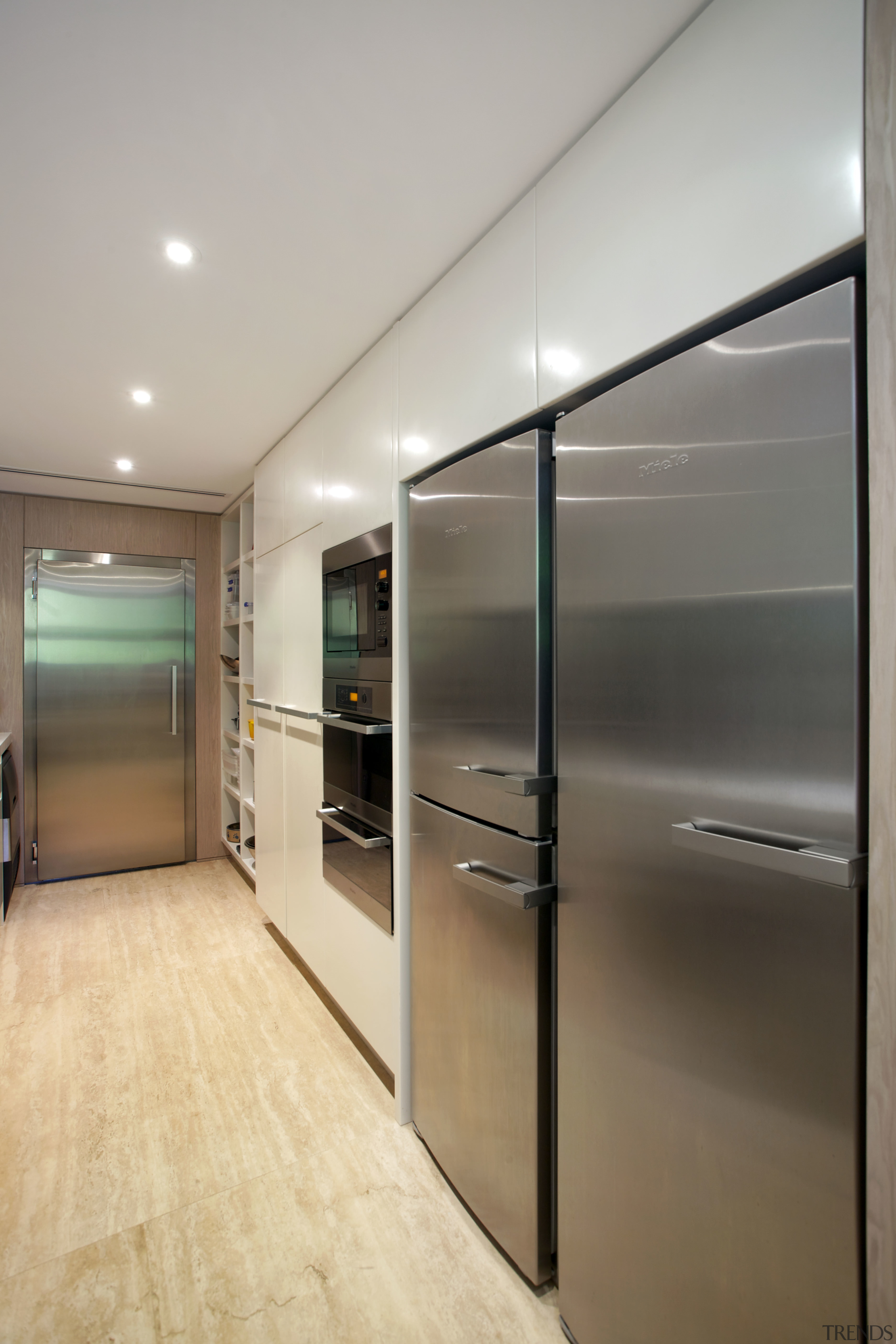 A second kitchen in this renovated house runs cabinetry, interior design, kitchen, real estate, gray