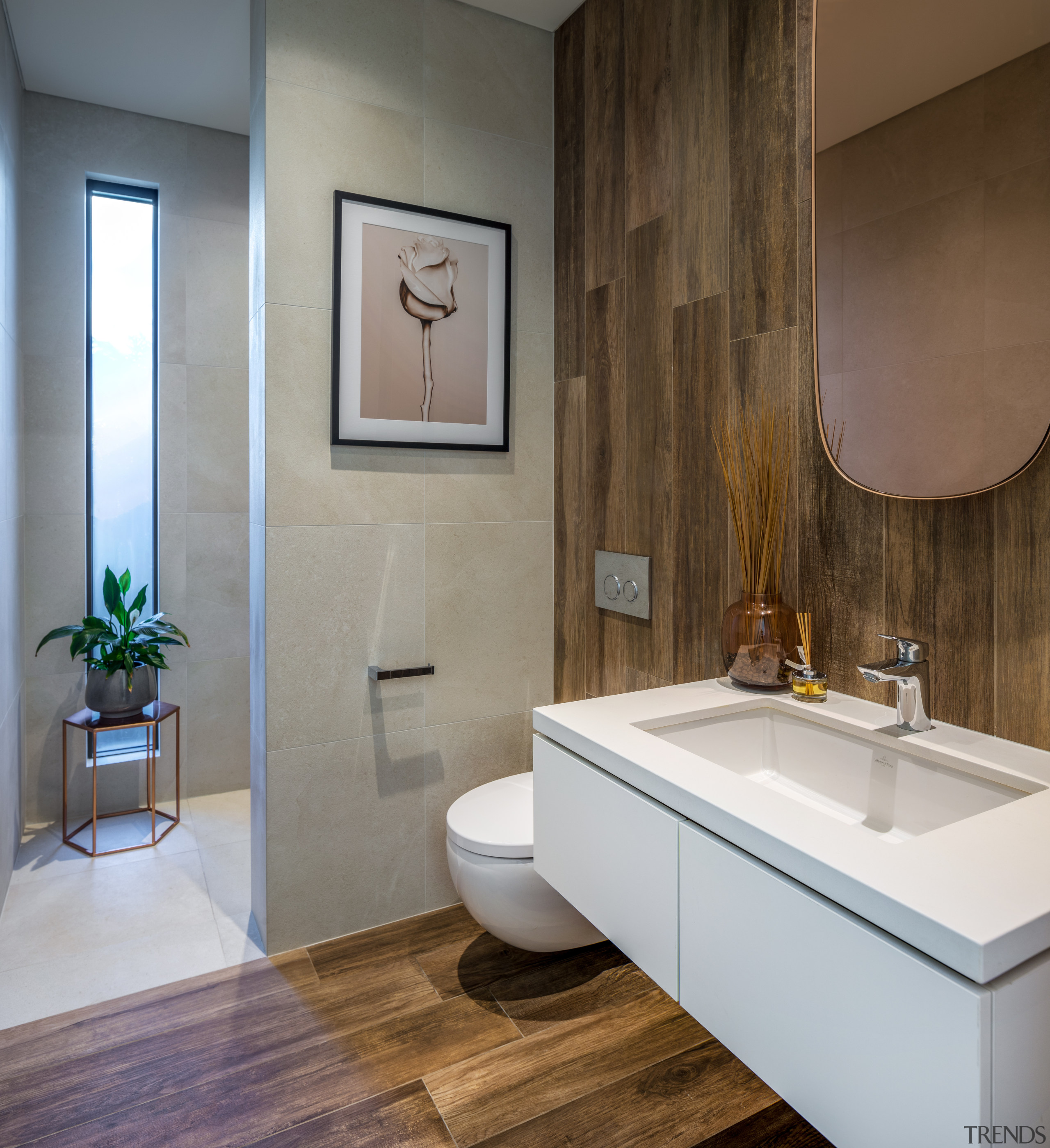 Natural materials and tall, slender windows are recurring architecture, bathroom, bathroom accessory, bathroom cabinet, bathtub, beige, bidet, building, ceiling, ceramic, floor, flooring, furniture, hardwood, home, house, interior design, marble, material property, plumbing fixture, property, real estate, room, sink, tap, tile, wall, gray, brown