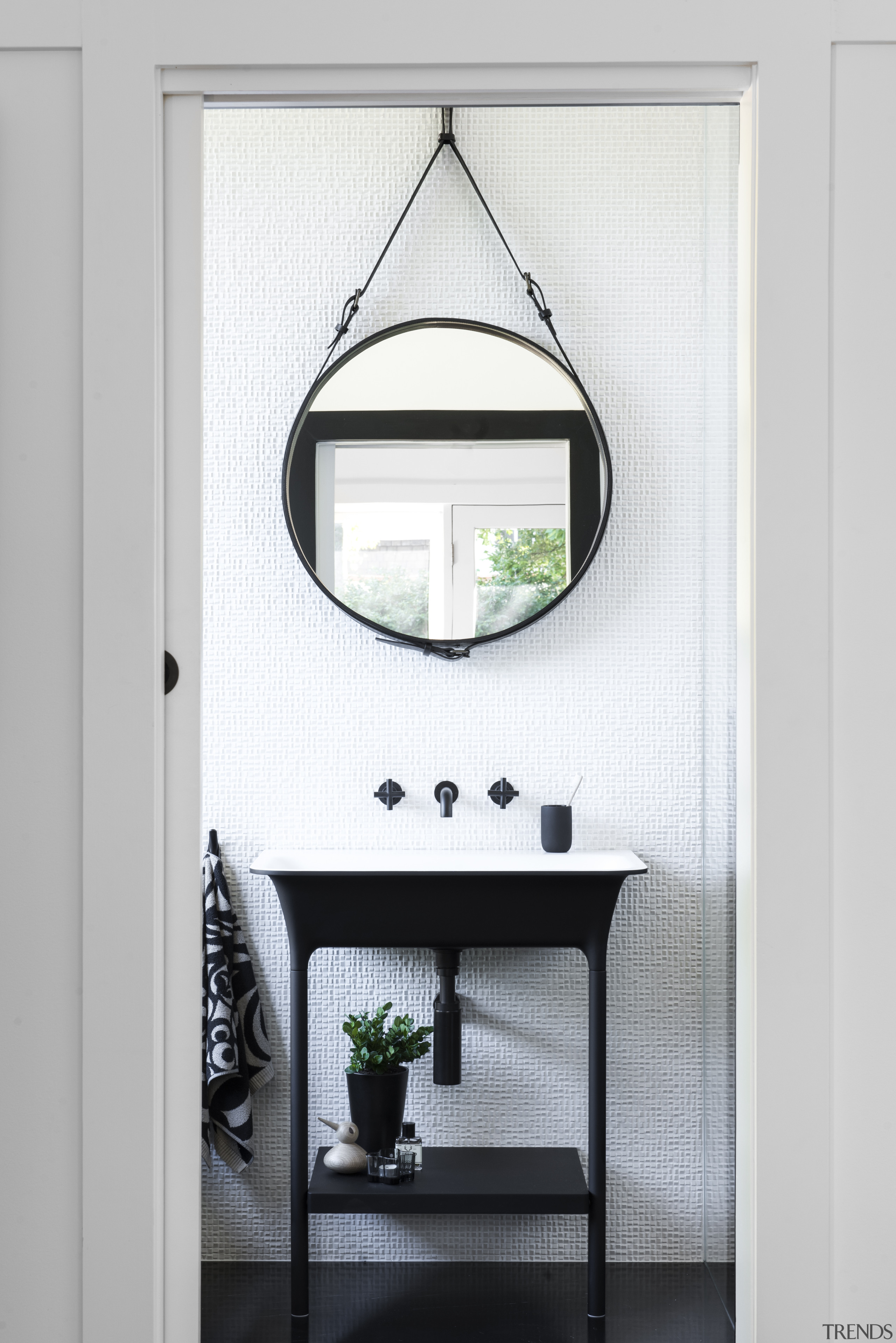 On this bathroom project by Minosa, stepping the mirror, bathroom, table, white, black, freestanding vanity, round mirror, Minosa, Darren Genner