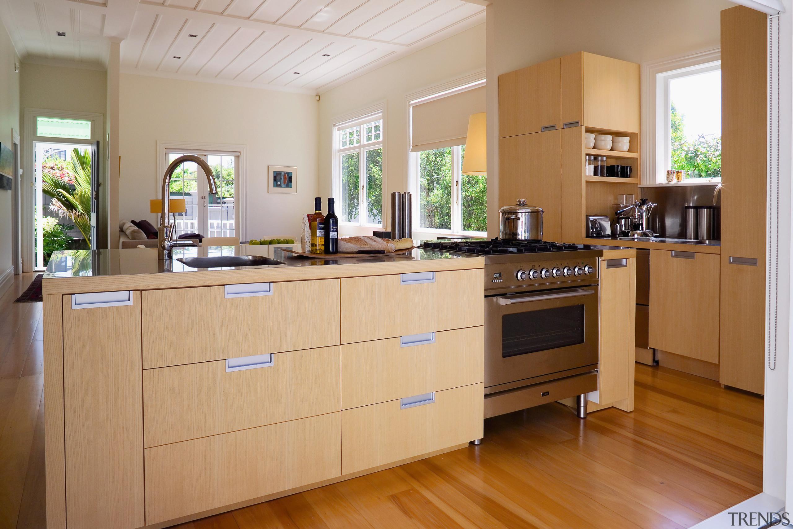 A view of the kitchen area, wooden flooring cabinetry, countertop, floor, flooring, interior design, kitchen, room, brown, orange