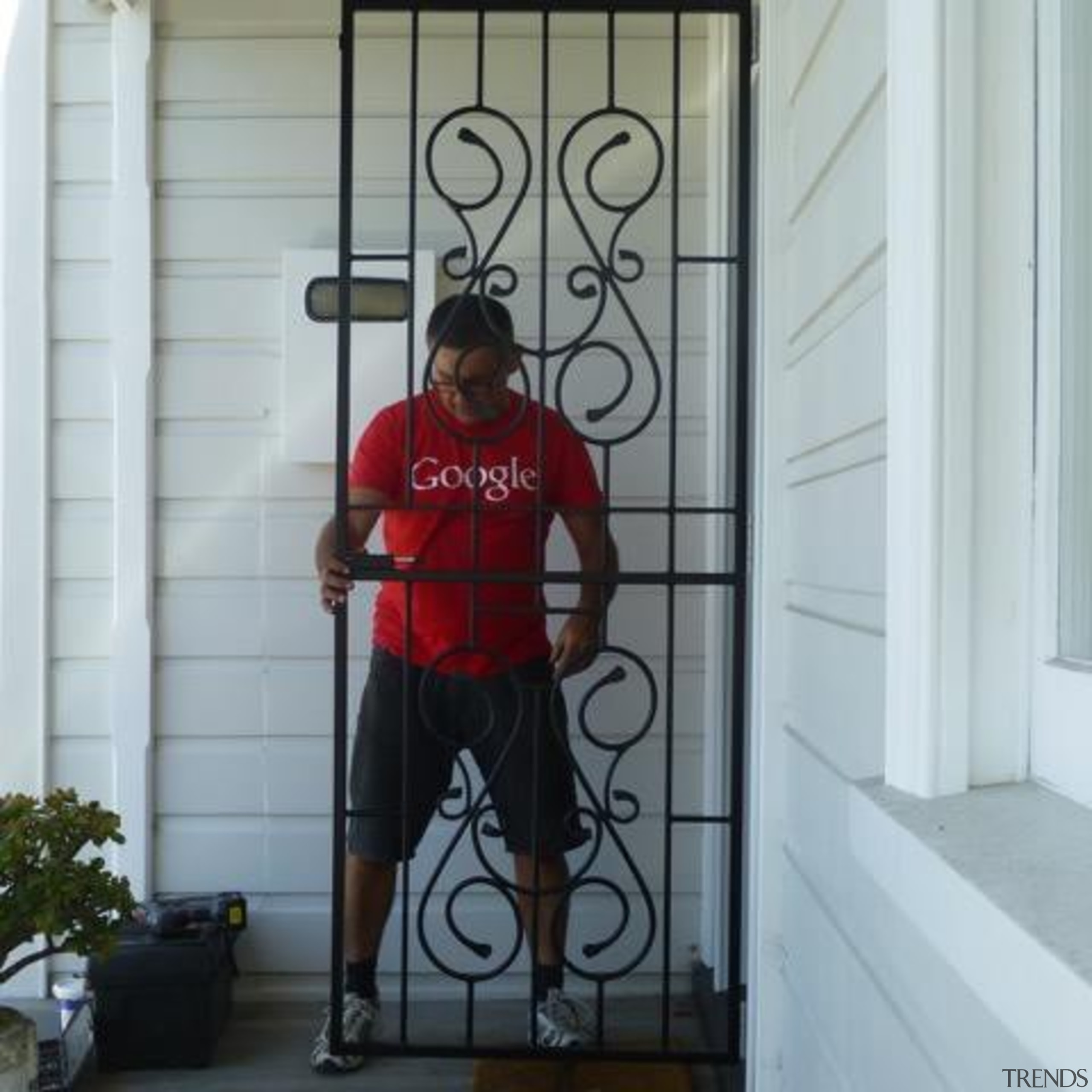 Have you been looking for something a little door, glass, iron, outerwear, red, shoulder, standing, structure, window, gray