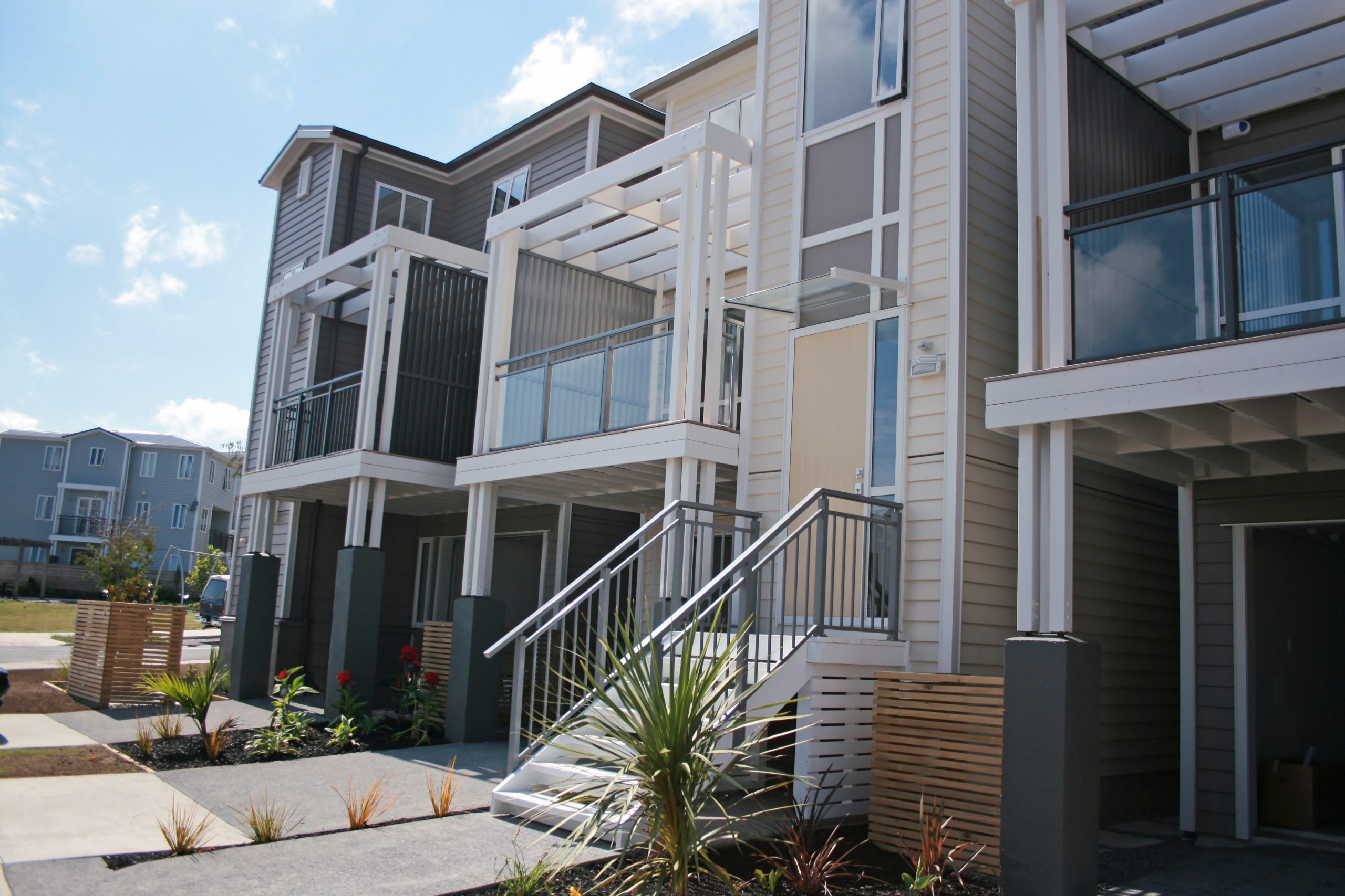 Finished homes with the different balustrades on the apartment, building, condominium, elevation, facade, home, house, mixed use, neighbourhood, property, real estate, residential area, siding, window, gray, black