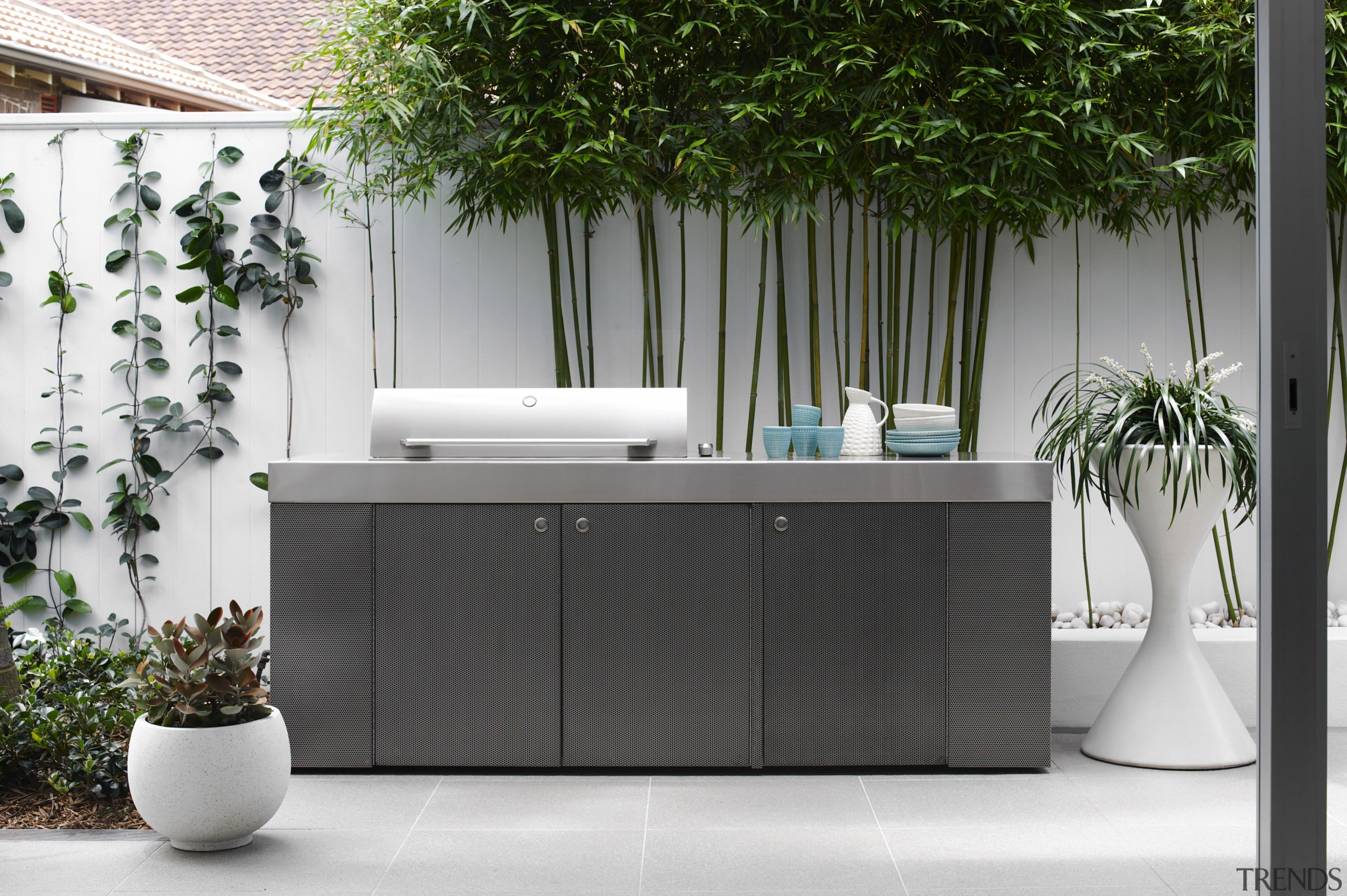 This large custom barbecue designed by Secret Gardens flowerpot, furniture, interior design, product design, table, gray, white