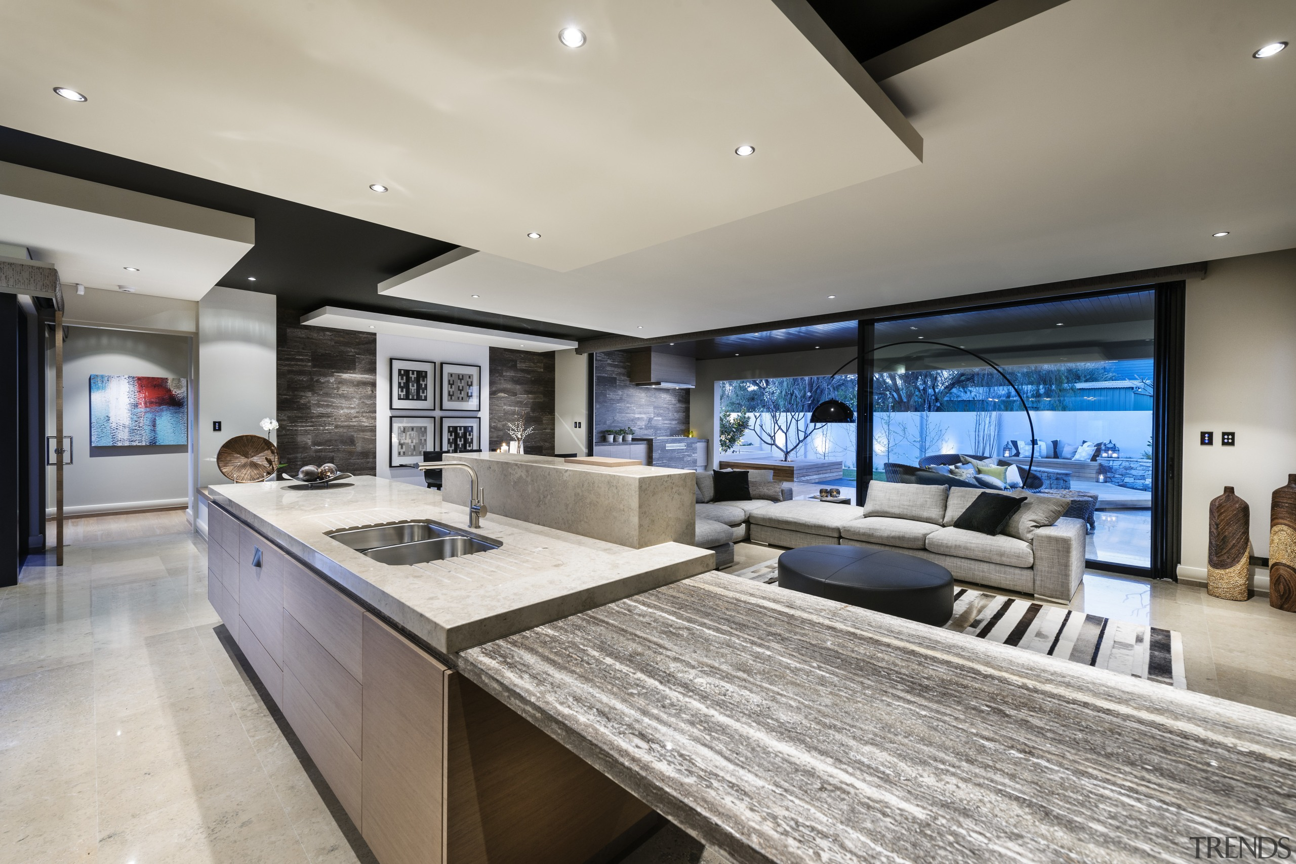 Kitchen connects with living spaces by shared palette countertop, estate, interior design, kitchen, living room, real estate, gray