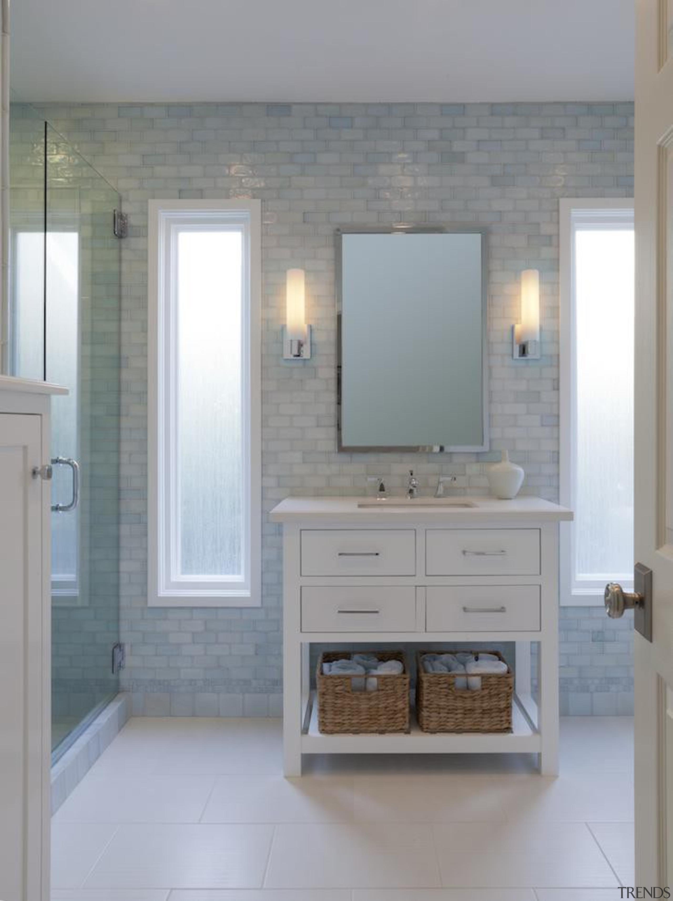 This bathroom evokes a spa like serene feel. bathroom, bathroom accessory, bathroom cabinet, cabinetry, floor, flooring, hardwood, home, interior design, room, sink, tile, wall, wood flooring, wood stain, gray
