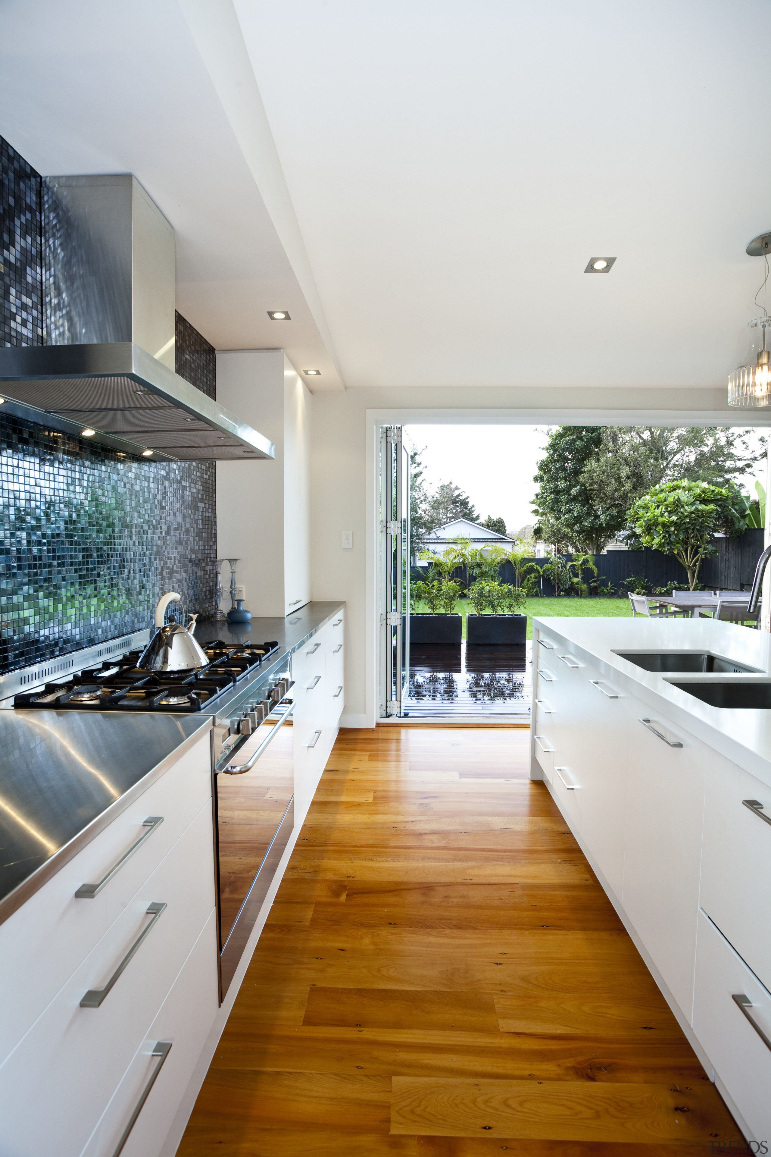 Kitchen designed by Yellow Fox, manufactured by Quality architecture, countertop, daylighting, floor, flooring, hardwood, home, house, interior design, kitchen, property, real estate, room, window, wood flooring, gray, white