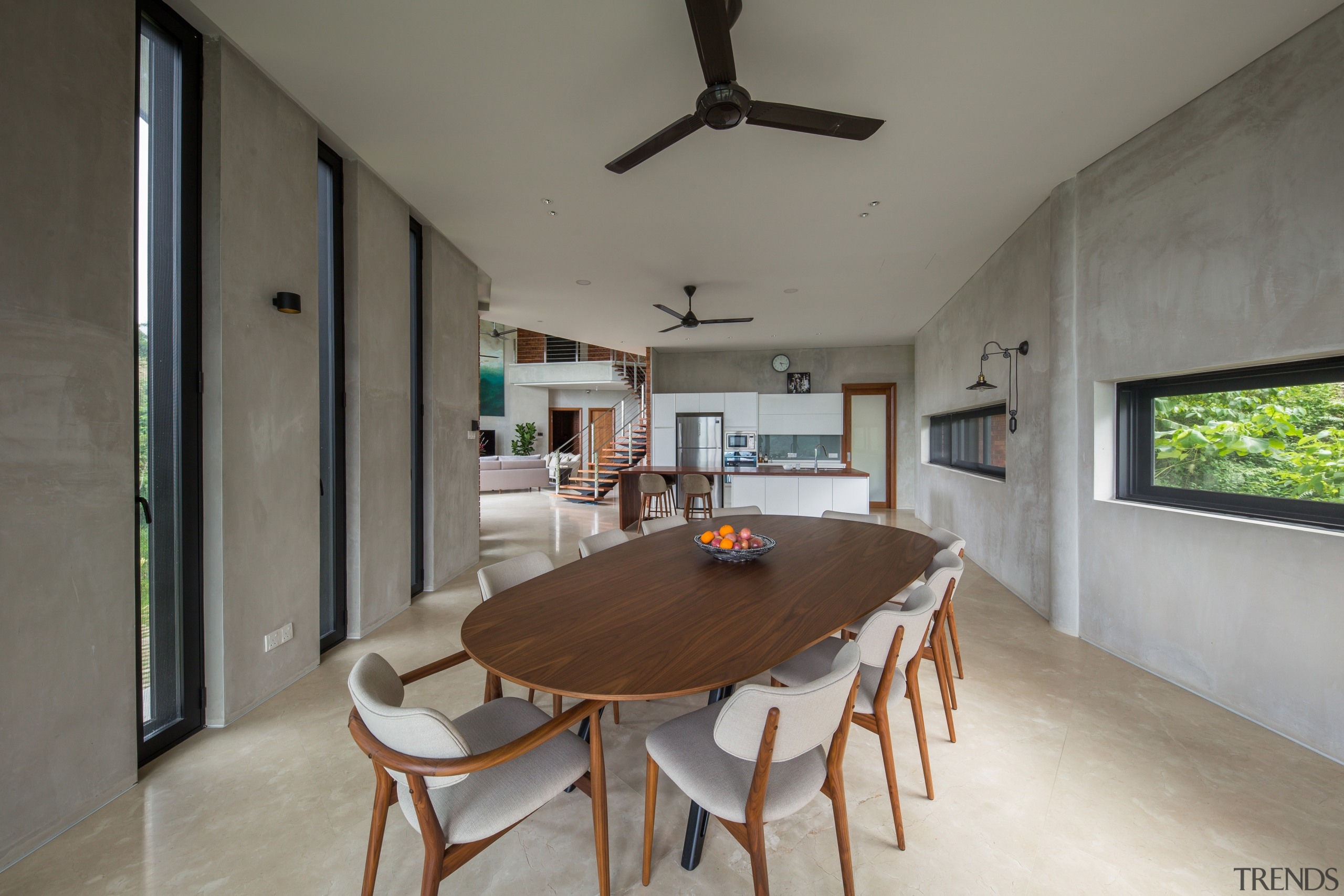 The dining area includes a classic ceiling fan. architecture, building, ceiling, dining room, floor, furniture, home, house, interior design, property, real estate, room, table, gray