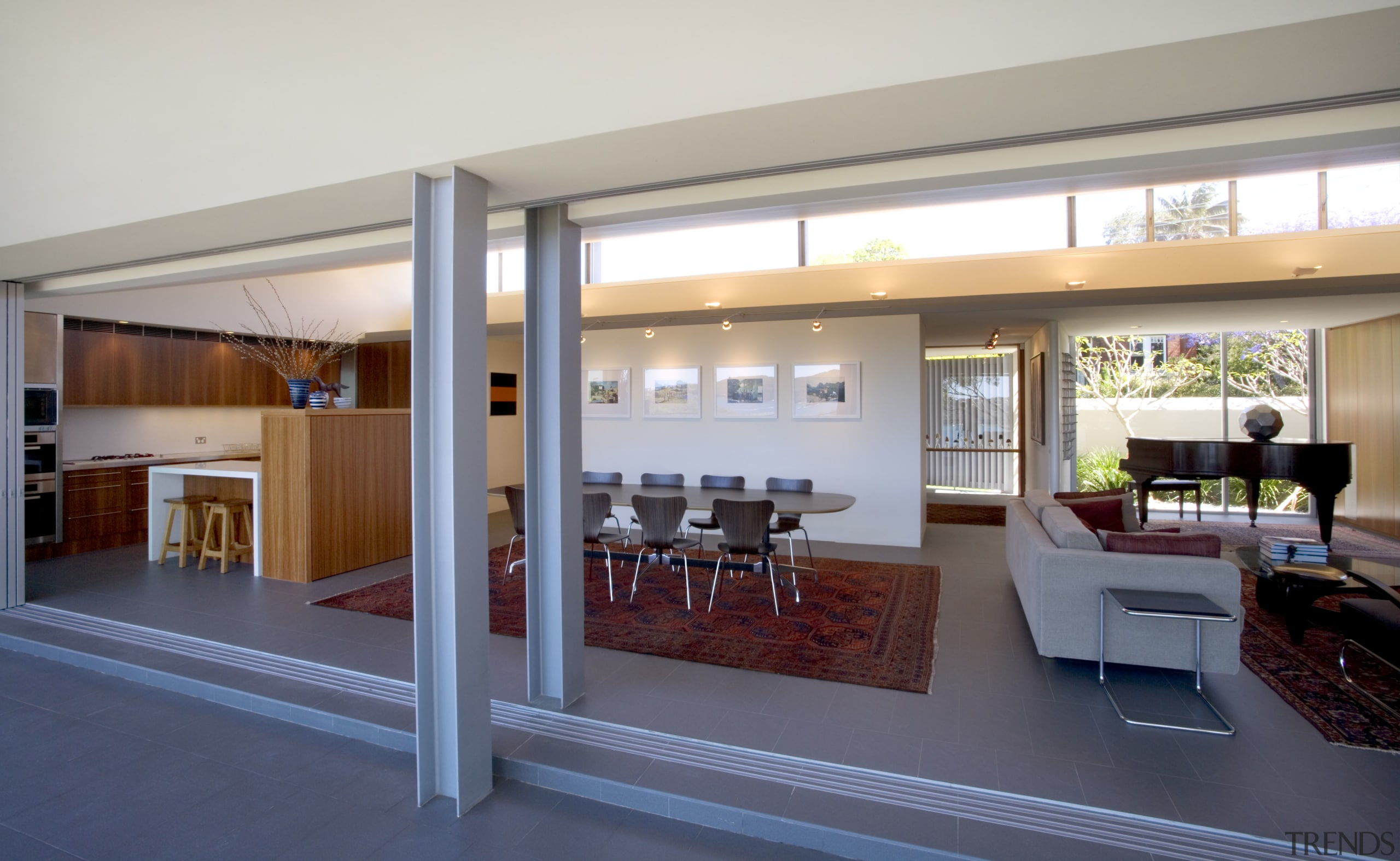 The entrance way is to the left of architecture, door, house, interior design, living room, real estate, window, gray