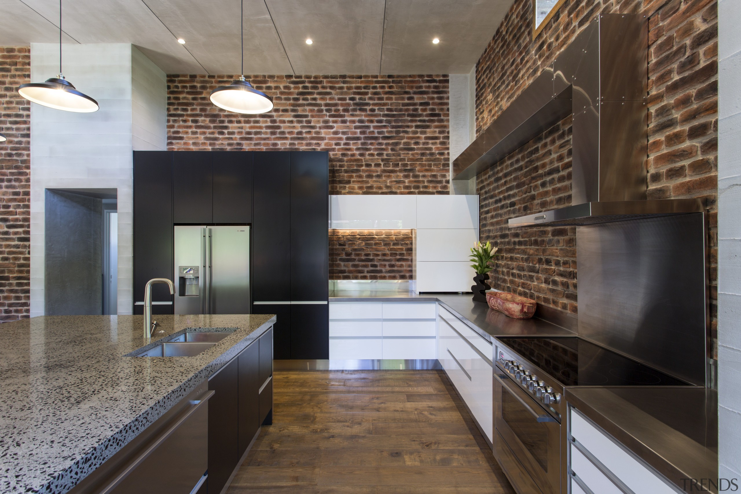 An L shape repeats throughout the design of architecture, cabinetry, countertop, flooring, hardwood, interior design, kitchen, loft, real estate, wood flooring, gray, black