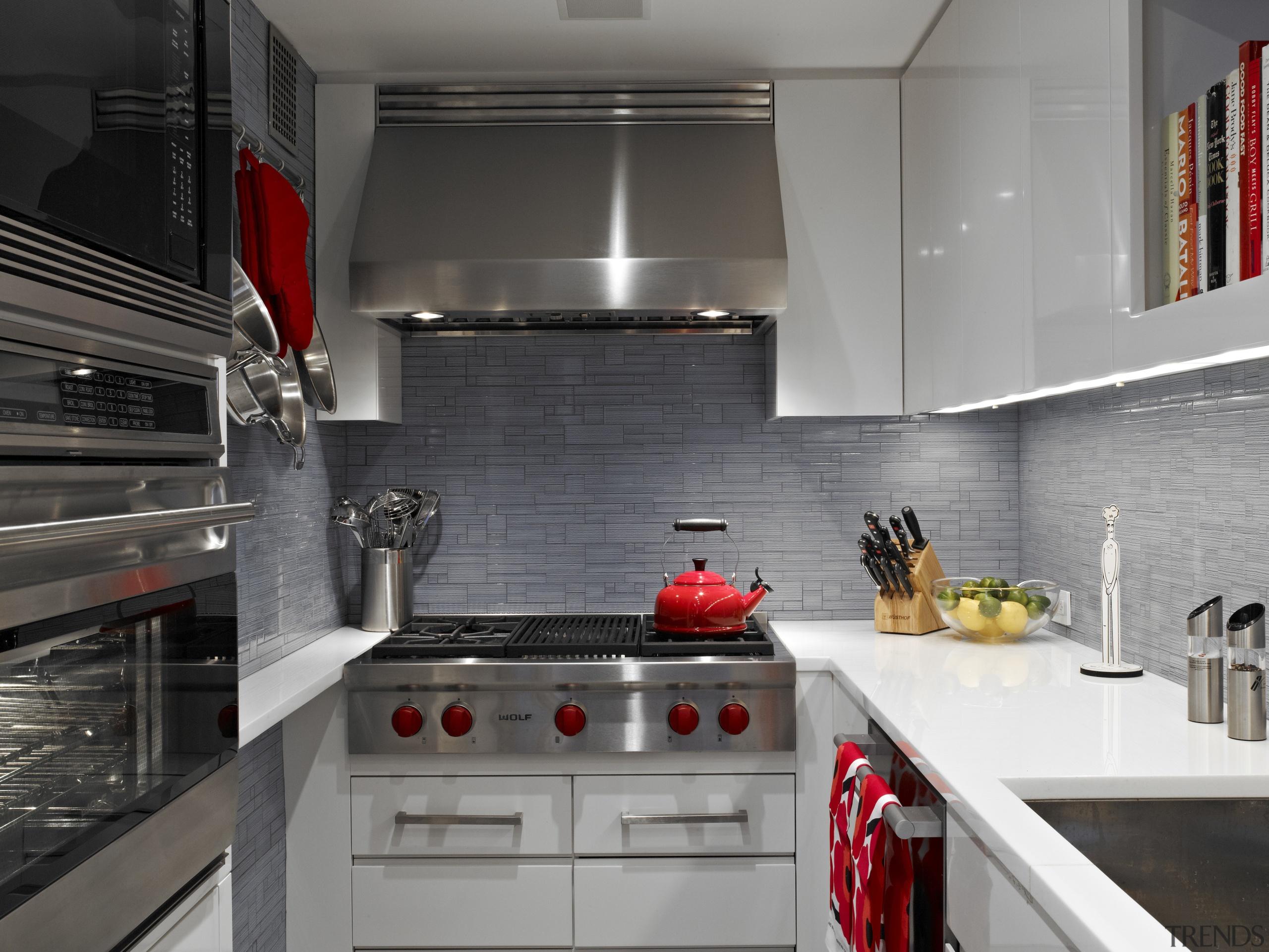 A narrow shelf next to the cooktop is countertop, interior design, kitchen, room, gray, black