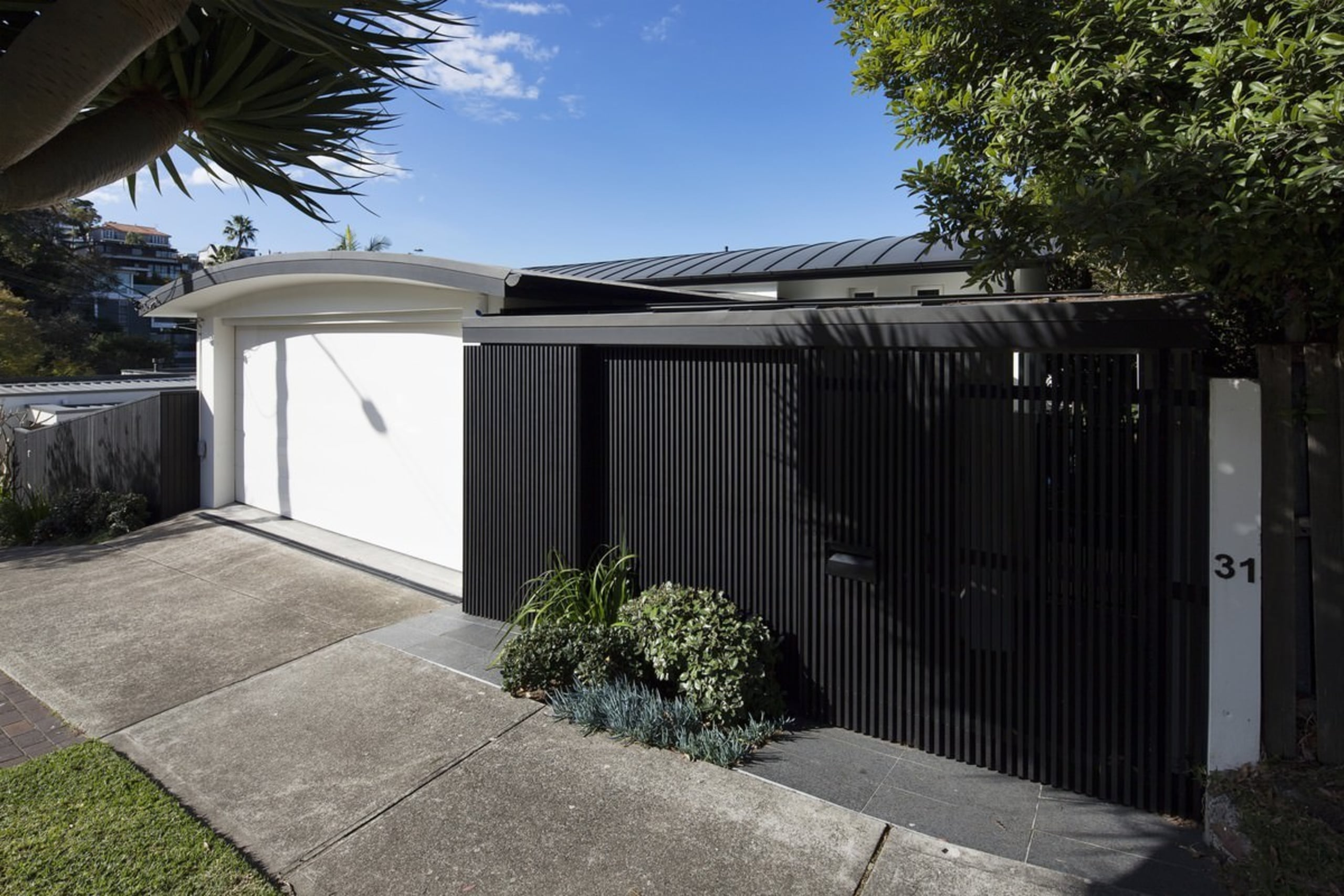 A closer view of the street-facing facade - architecture, facade, fence, home, house, outdoor structure, property, real estate, shed, black
