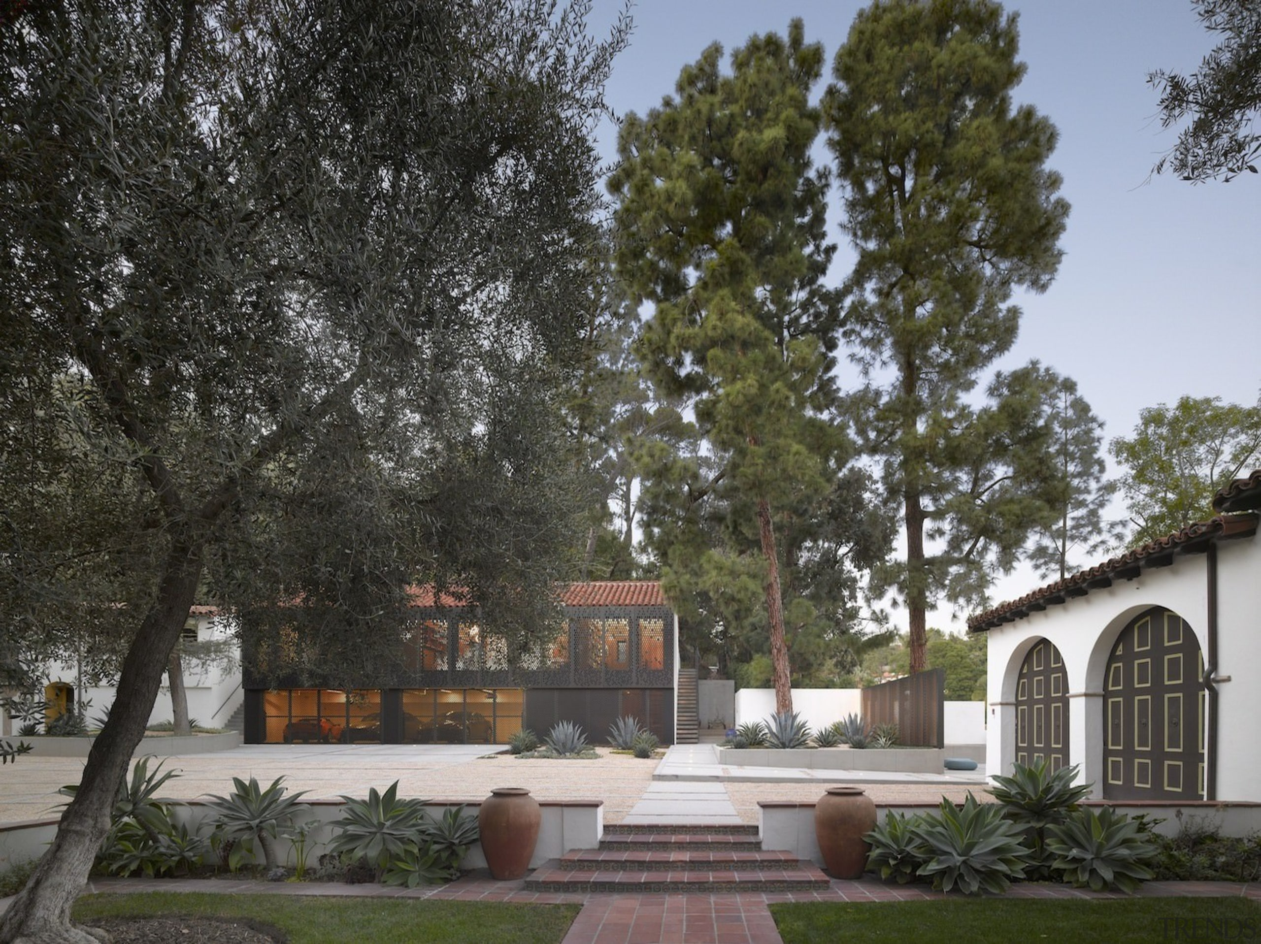 The project re-established many of the signature design architecture, cottage, estate, facade, hacienda, home, house, landscape, outdoor structure, property, real estate, residential area, tree, villa, black, gray