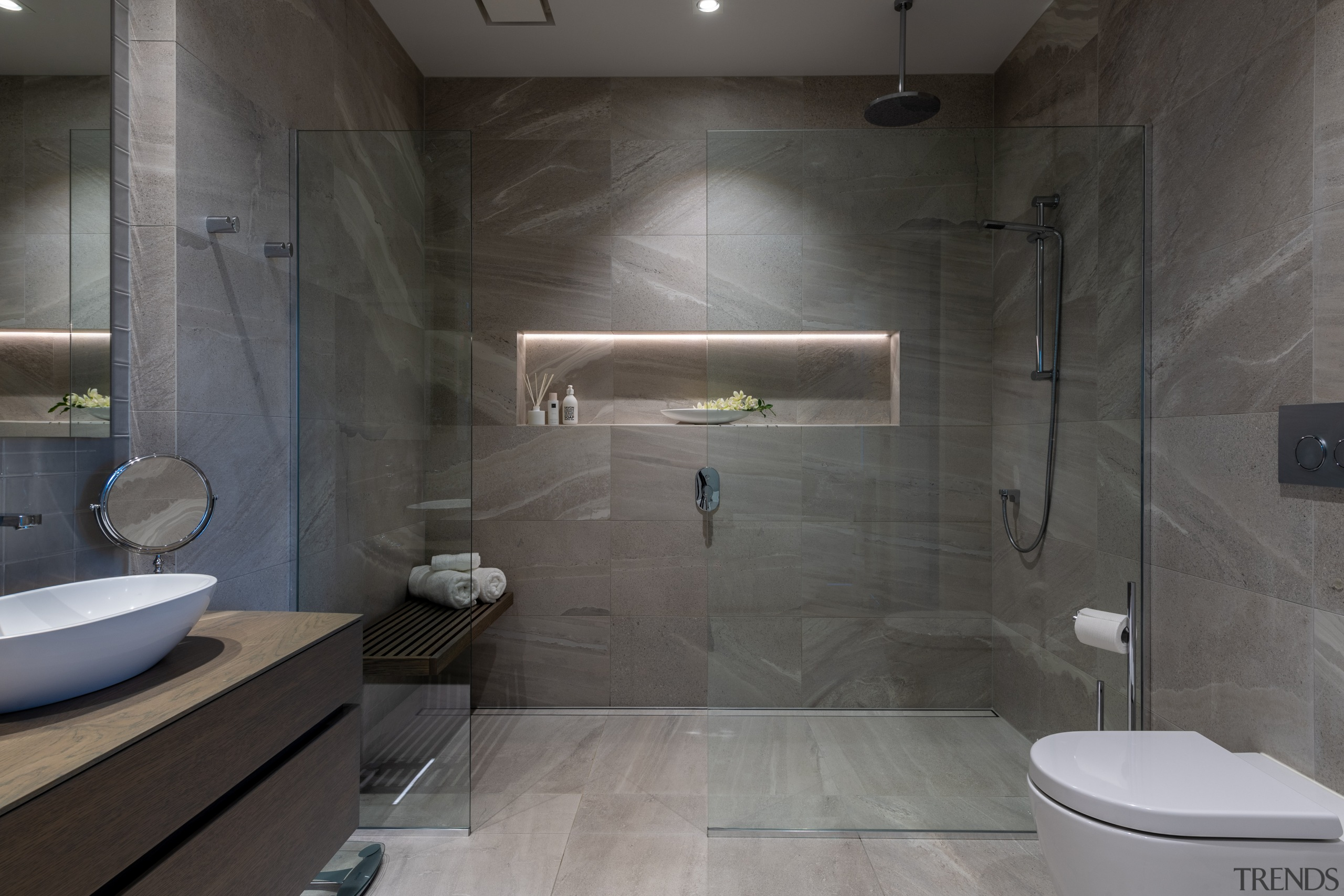 Running the same large-format tiles through the bathroom