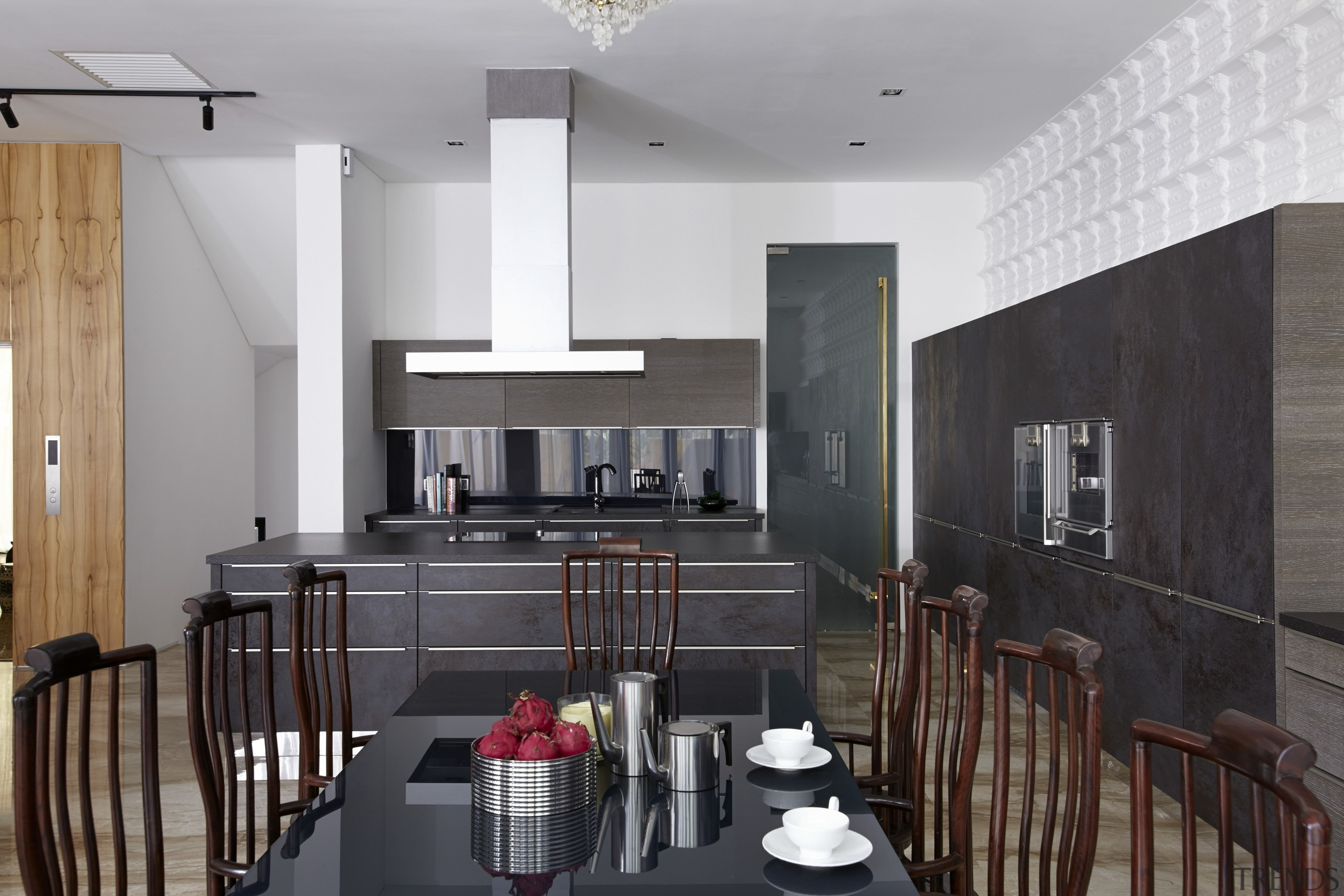 While the dry kitchen, seen here, is the architecture, interior design, kitchen, real estate, room, gray, black