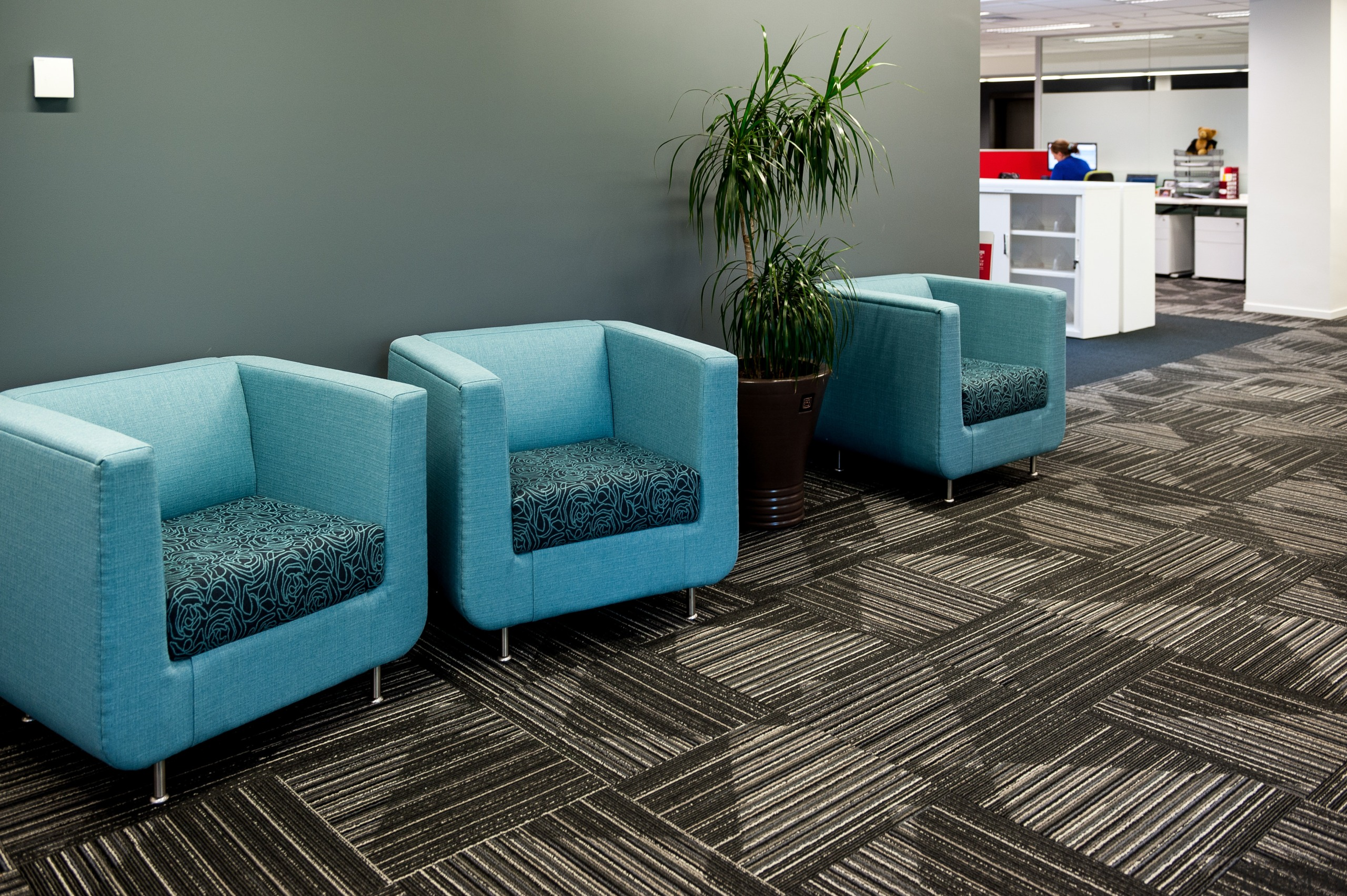 Durable, good-looking carpet tiles for commercial use.  chair, floor, flooring, furniture, hardwood, interior design, living room, product design, table, waiting room, gray, black