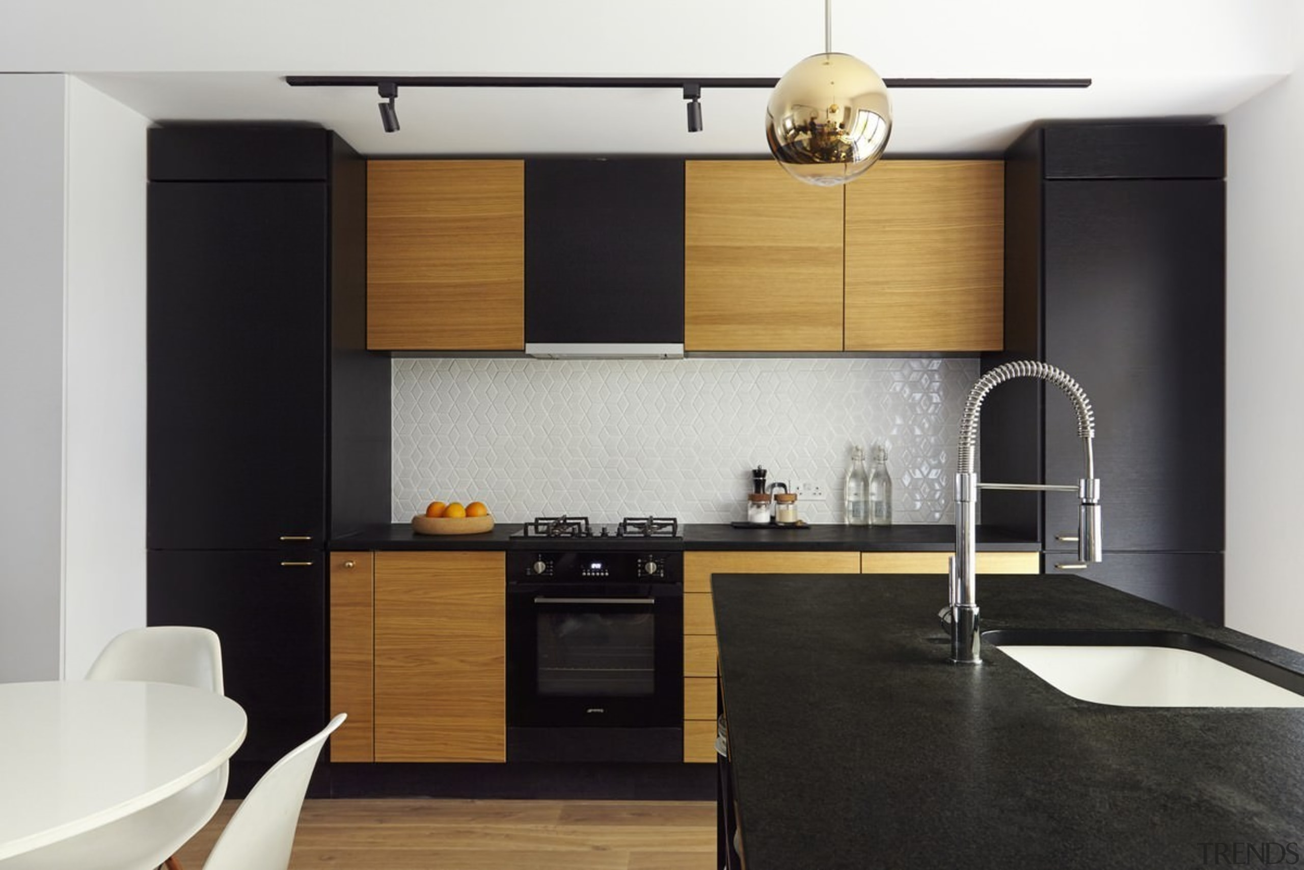 Contrasting elements come together in the kitchen - cabinetry, countertop, cuisine classique, floor, interior design, kitchen, product design, black