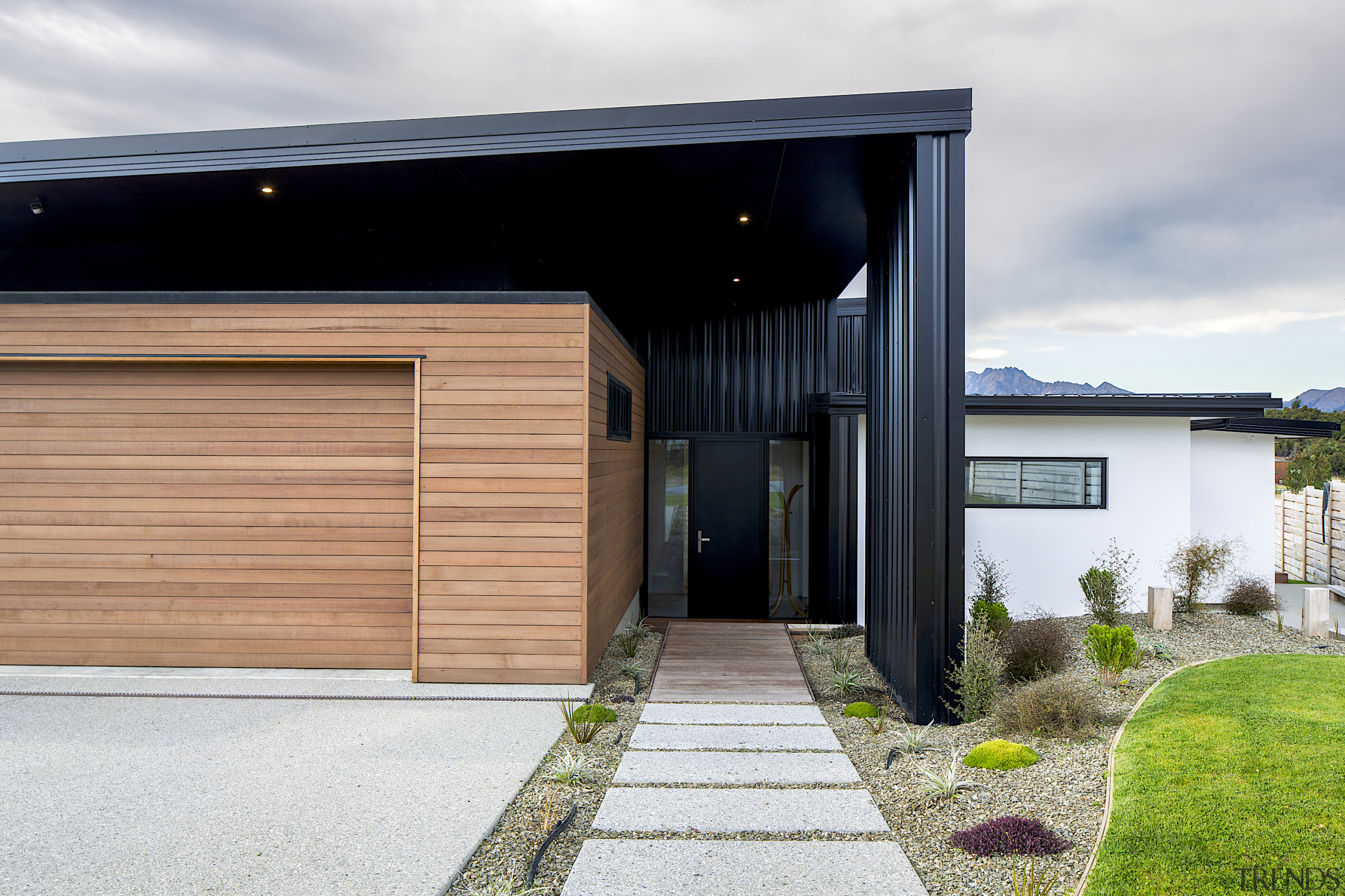 Matched with horizontal cedar weatherboards and white plaster, white