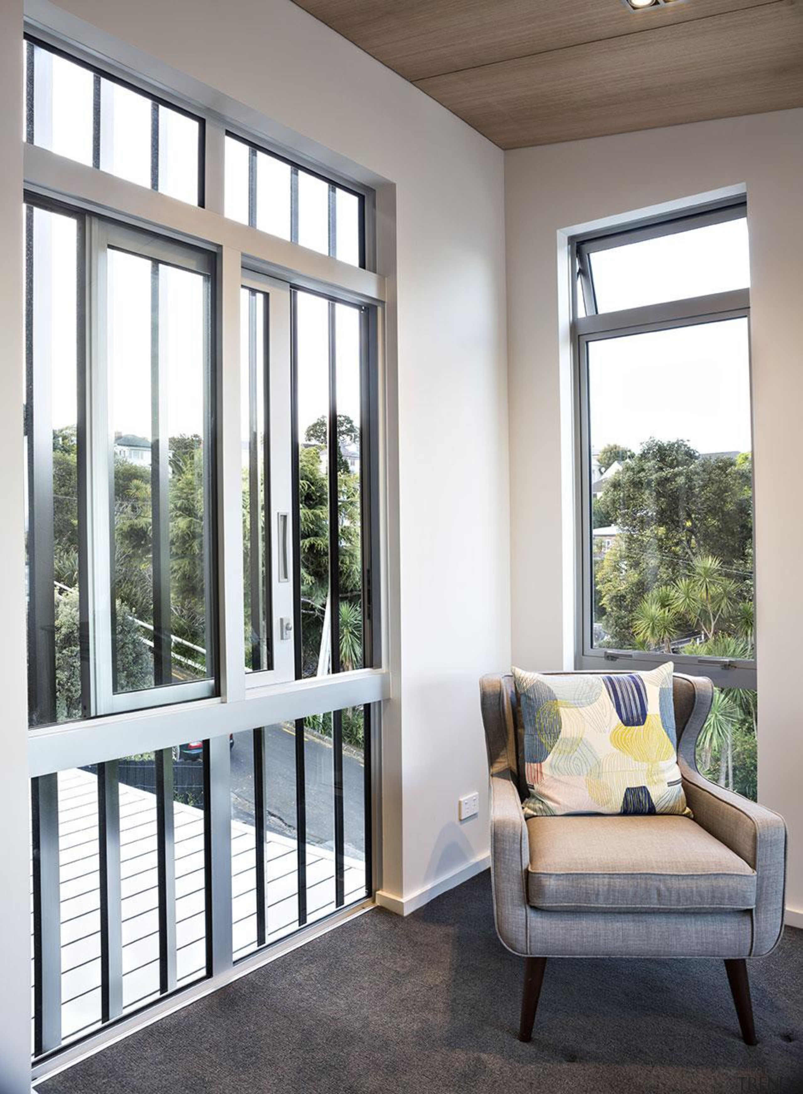 Eastern views are enjoyed from the formal living daylighting, door, estate, home, house, interior design, living room, real estate, sash window, window, white, gray