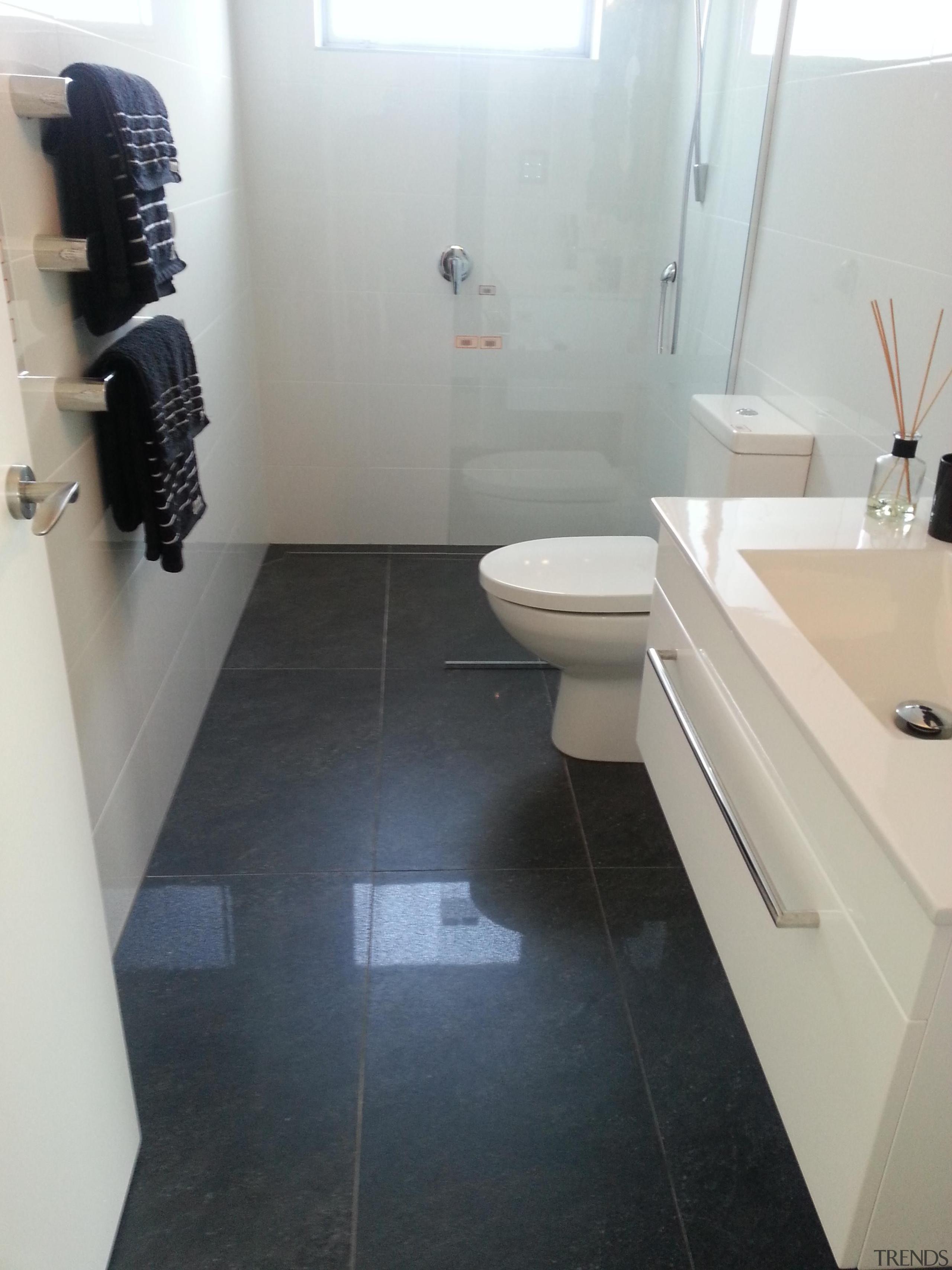 Anthracite bathroom floor and Easy White Gloss wall. bathroom, floor, flooring, hardwood, interior design, plumbing fixture, property, room, sink, tile, gray, black
