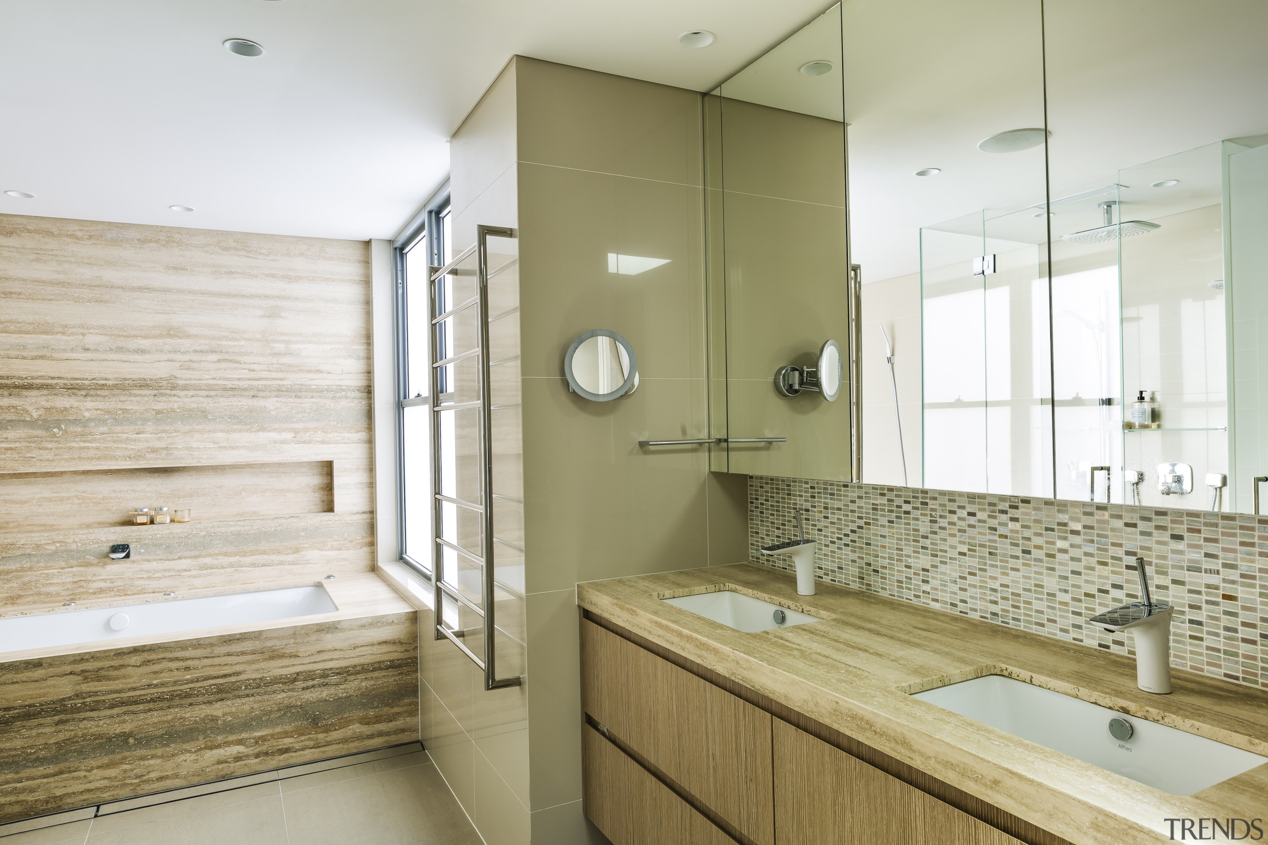 The ensuite cabinetry in this master suite continues architecture, bathroom, home, bathroom design, white, master suite, timber cabinetry, wood, timber, travertine, Giles & Tribe Architecture
