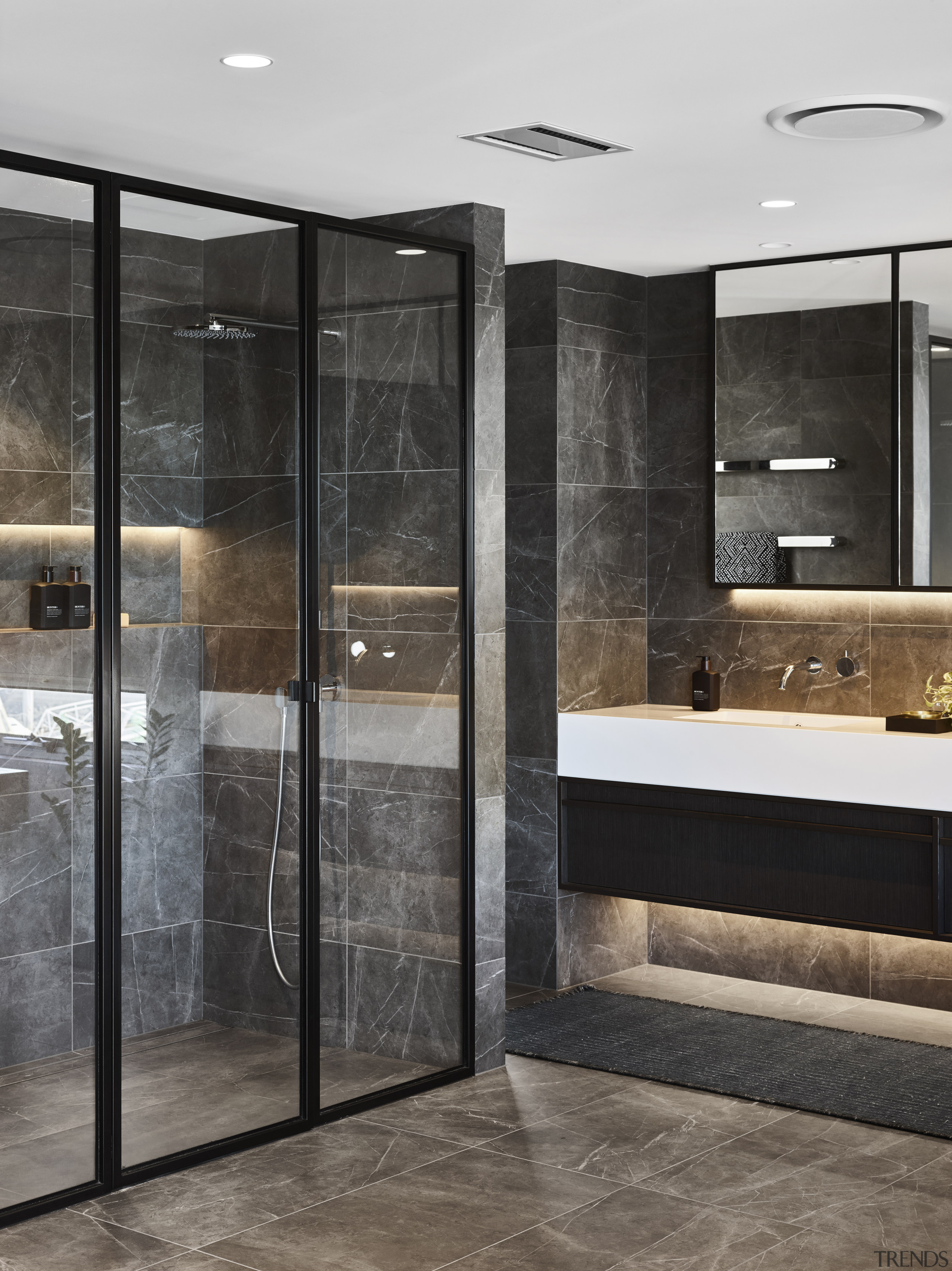 This shower nook is continued in the same architecture, automotive exterior, bathroom, building, ceiling, door, floor, flooring, furniture, glass, house, interior design, material property, property, room, shower, tile, gray, black