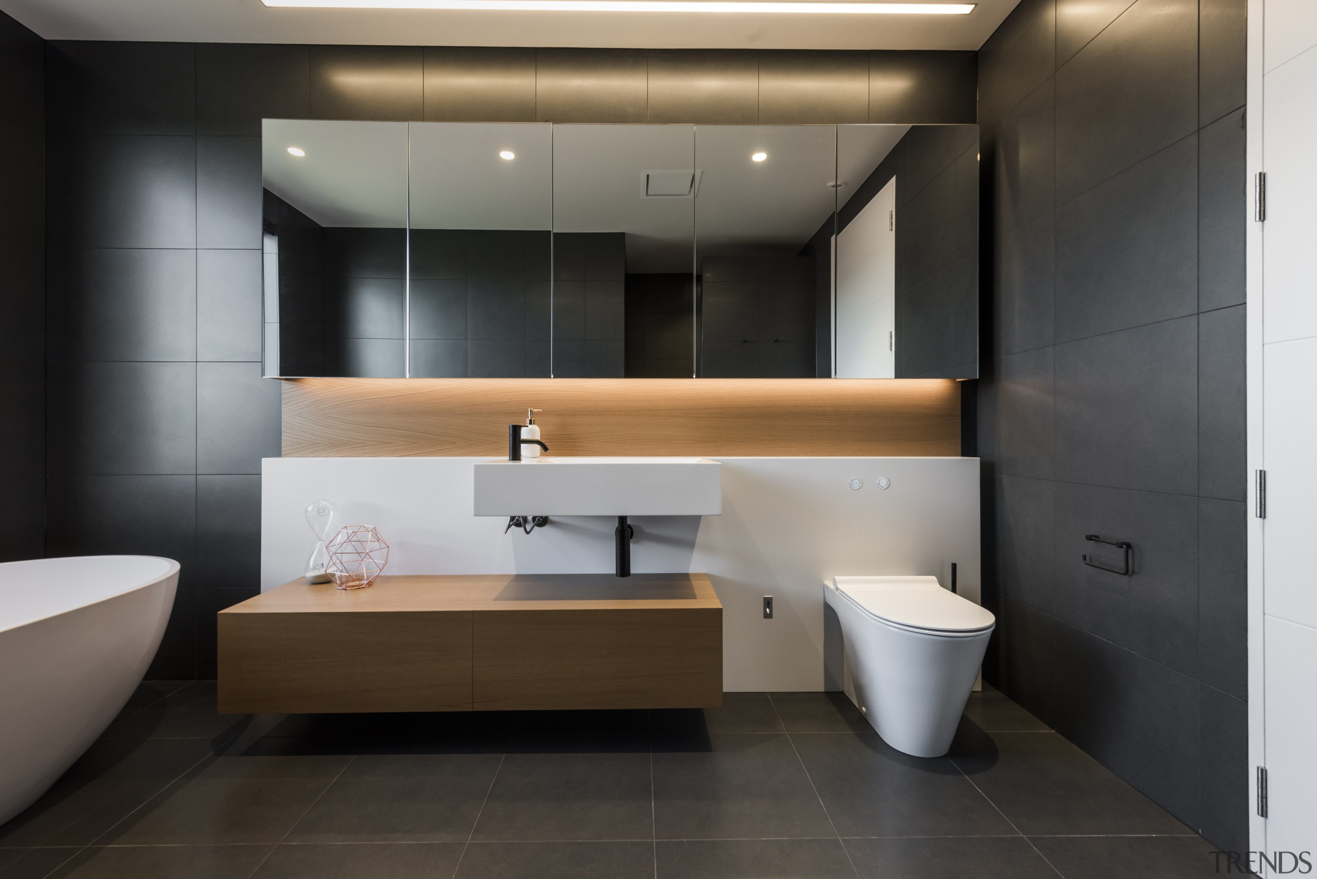 In this dramatic bathroom by professional design company bathroom, floor, flooring, interior design, black, tiles, timber vanity, Davinia Sutton