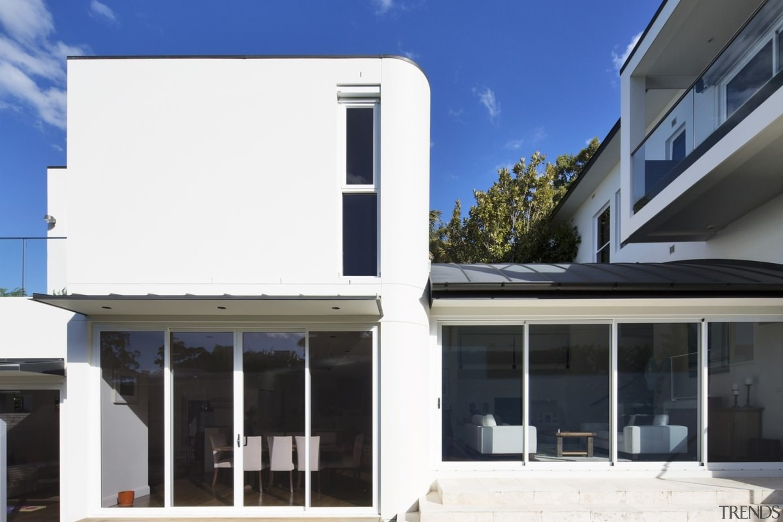 The home is centred around the location, facing architecture, building, elevation, facade, home, house, property, real estate, roof, window, white, black