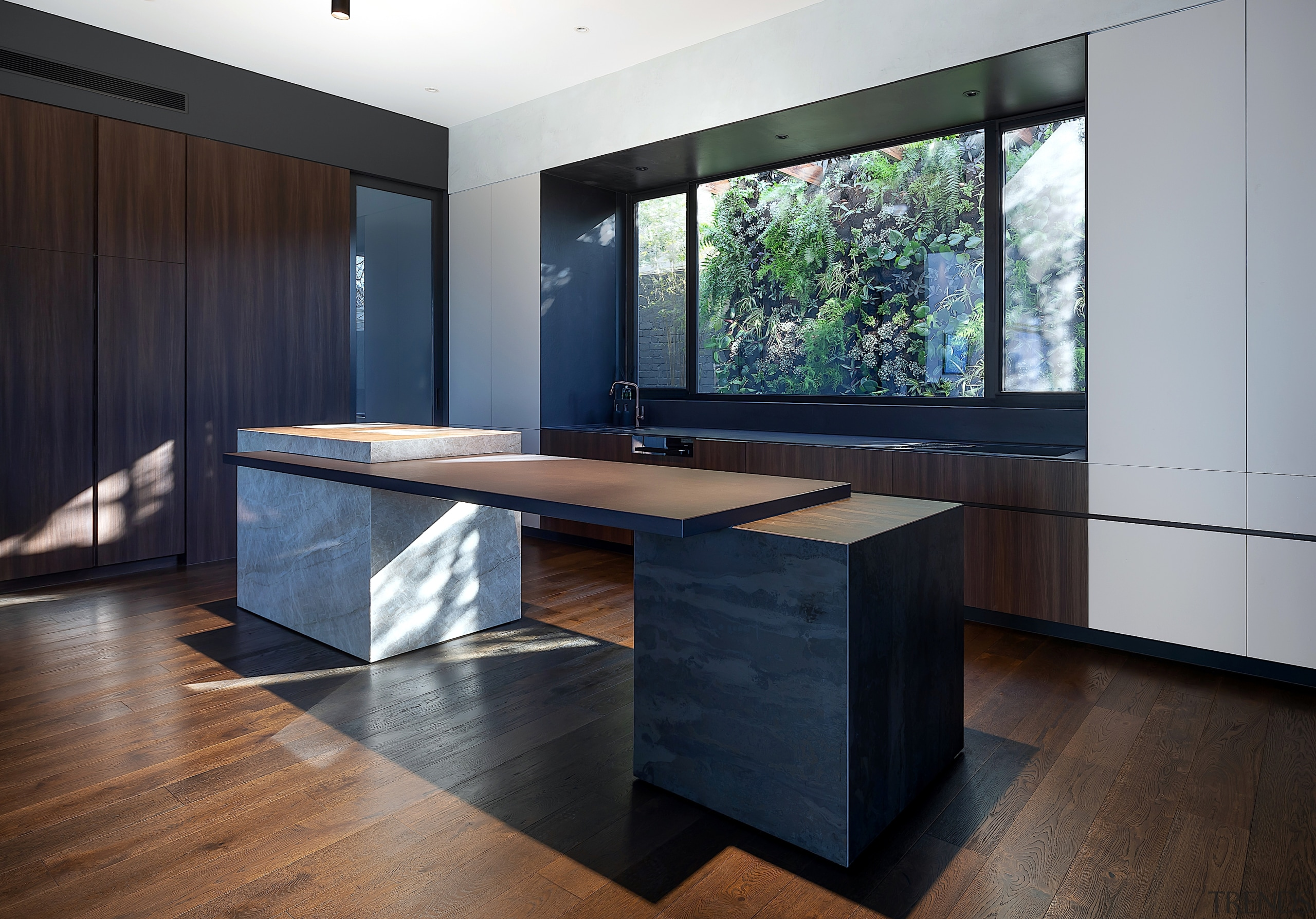The kitchen island is composed of elements that