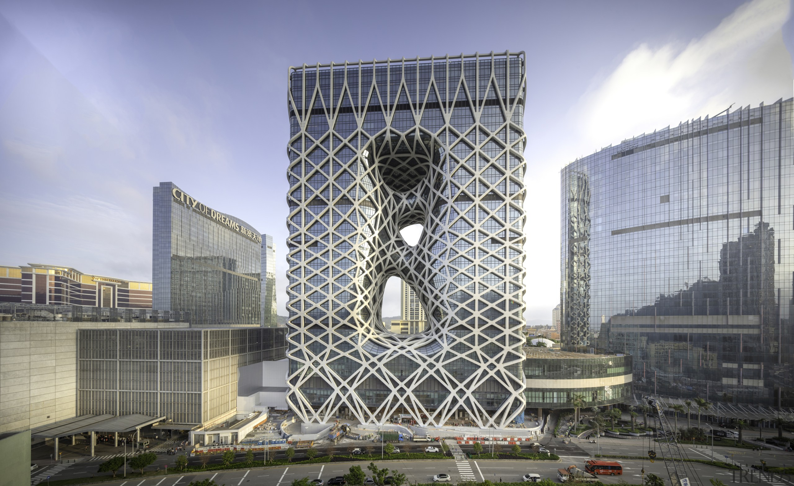 A fluid 'net' of structural beams forms the architecture, building, city, commercial building, condominium, corporate headquarters, daytime, headquarters, landmark, metropolis, metropolitan area, mixed use, sky, skyscraper, tower, tower block, teal, gray