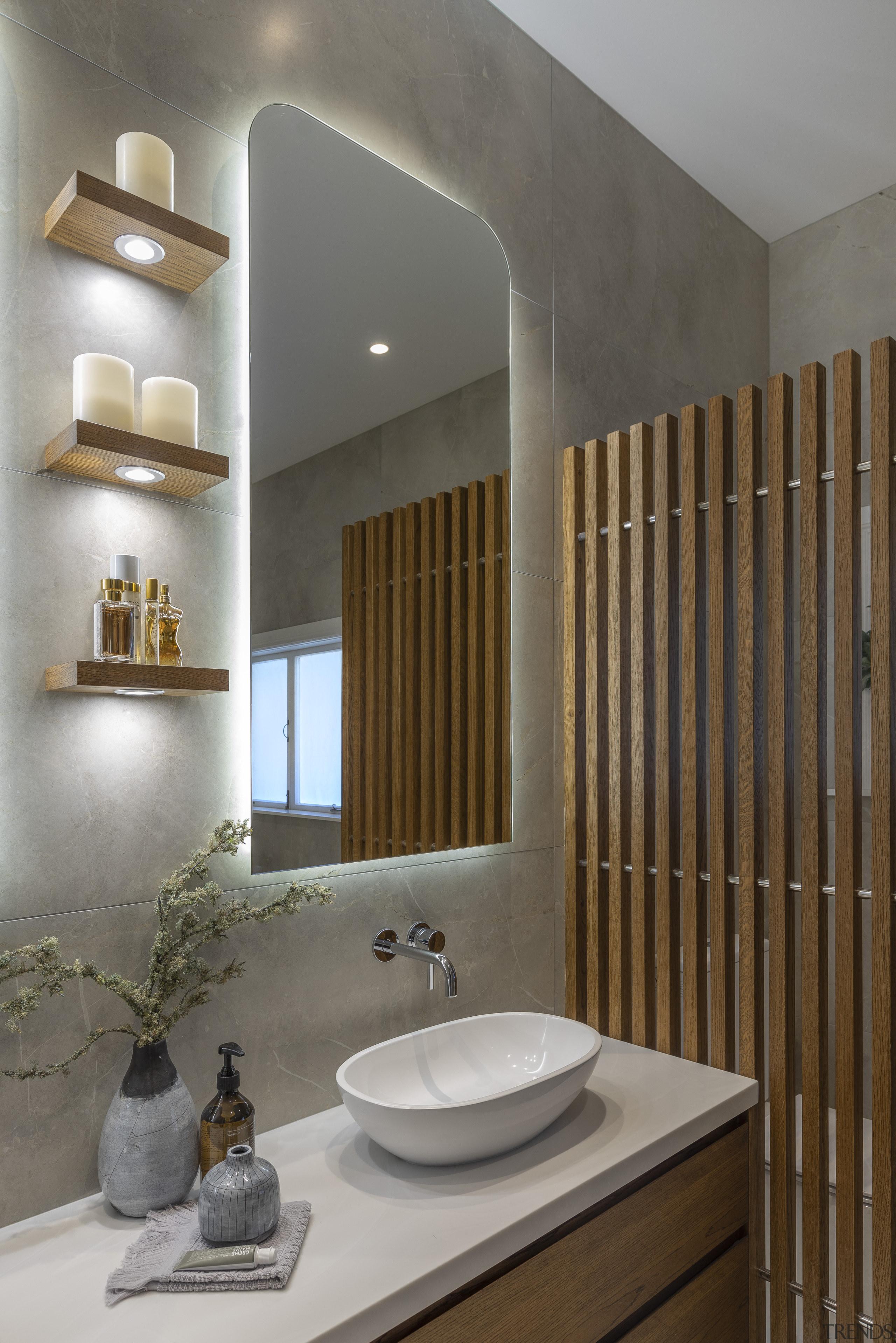 On this warm, elegant Kira Gray-designed main bathroom, gray