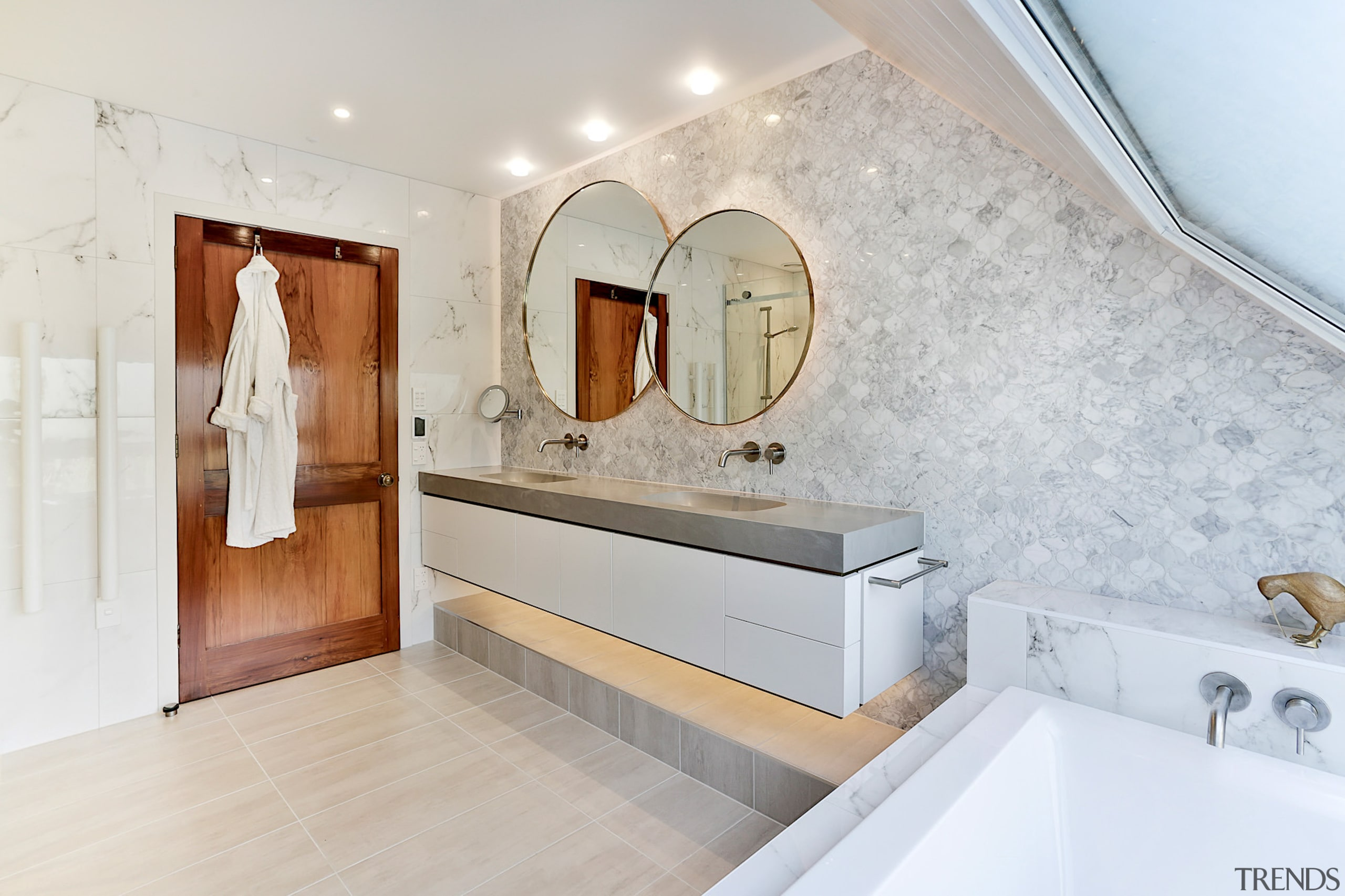 A large wooden door provides a dramatic contrast architecture, bathroom, building, ceiling, estate, floor, flooring, furniture, home, house, interior design, loft, property, real estate, room, sink, tap, tile, wall, gray, white