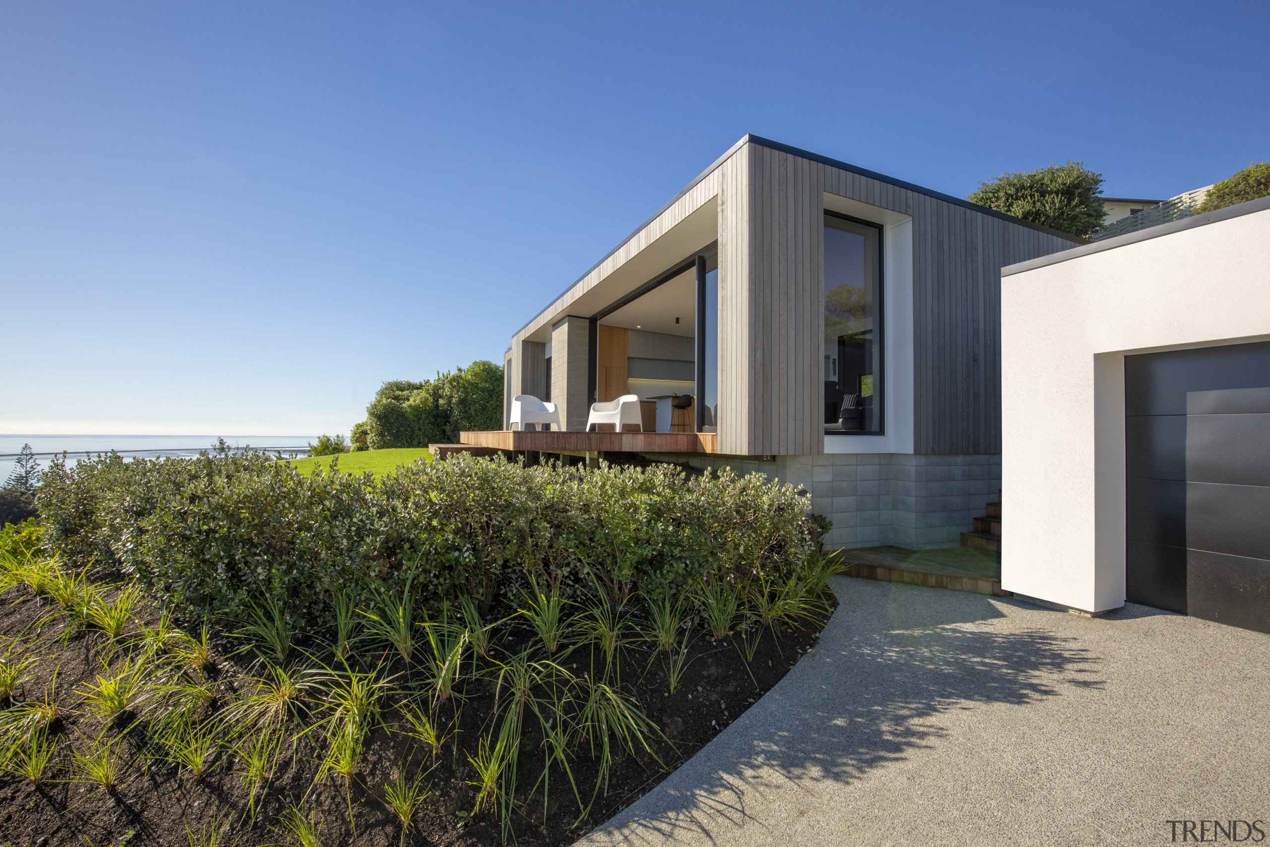 The siting of the house was a balancing architecture, cottage, estate, facade, home, house, property, real estate, villa, teal