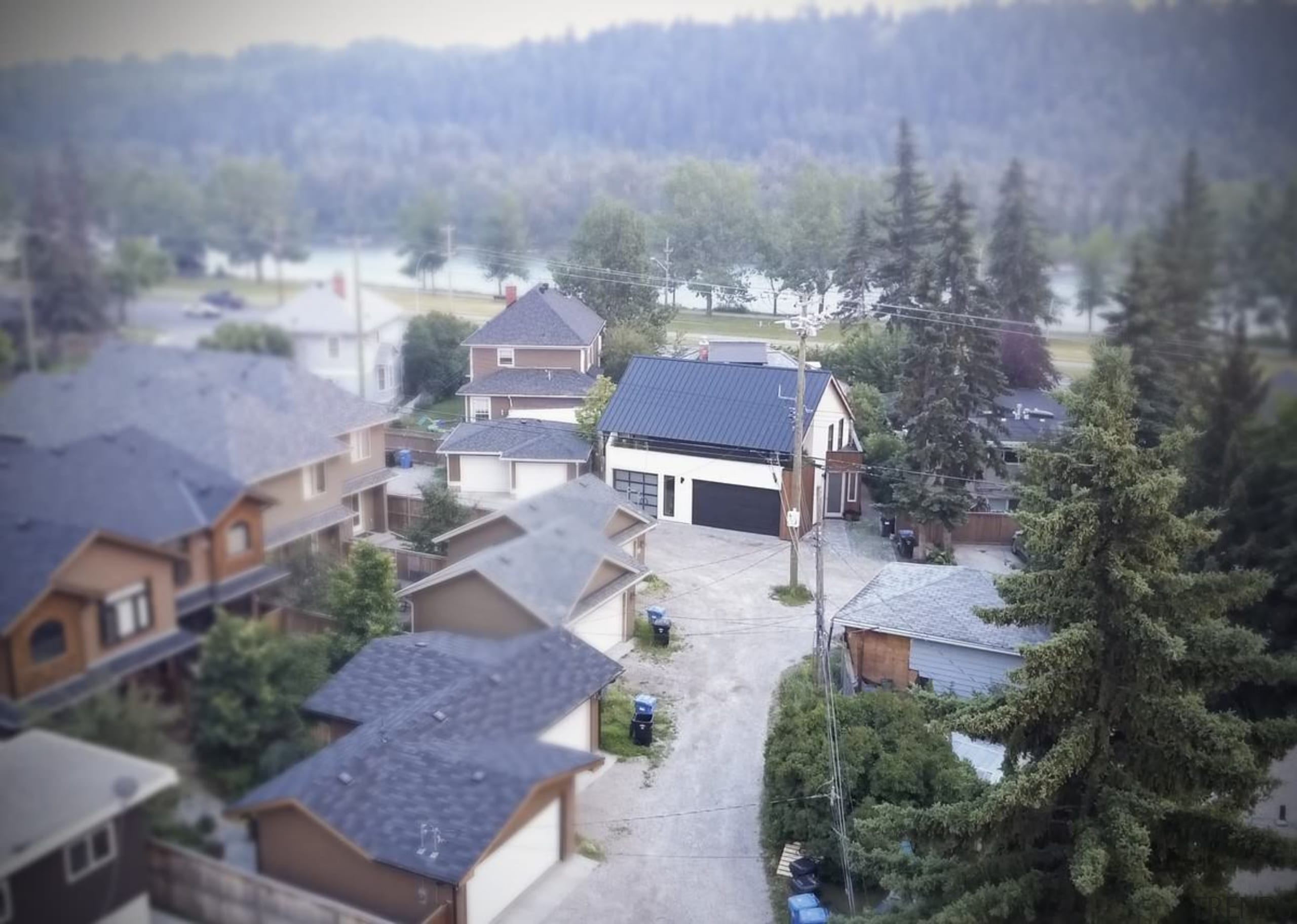 Models or a photo? This perspective is a architecture, city, cottage, estate, hill station, home, house, landscape, mountain, mountain range, neighbourhood, property, real estate, residential area, roof, rural area, sky, snow, suburb, town, tree, urban area, village, winter, gray