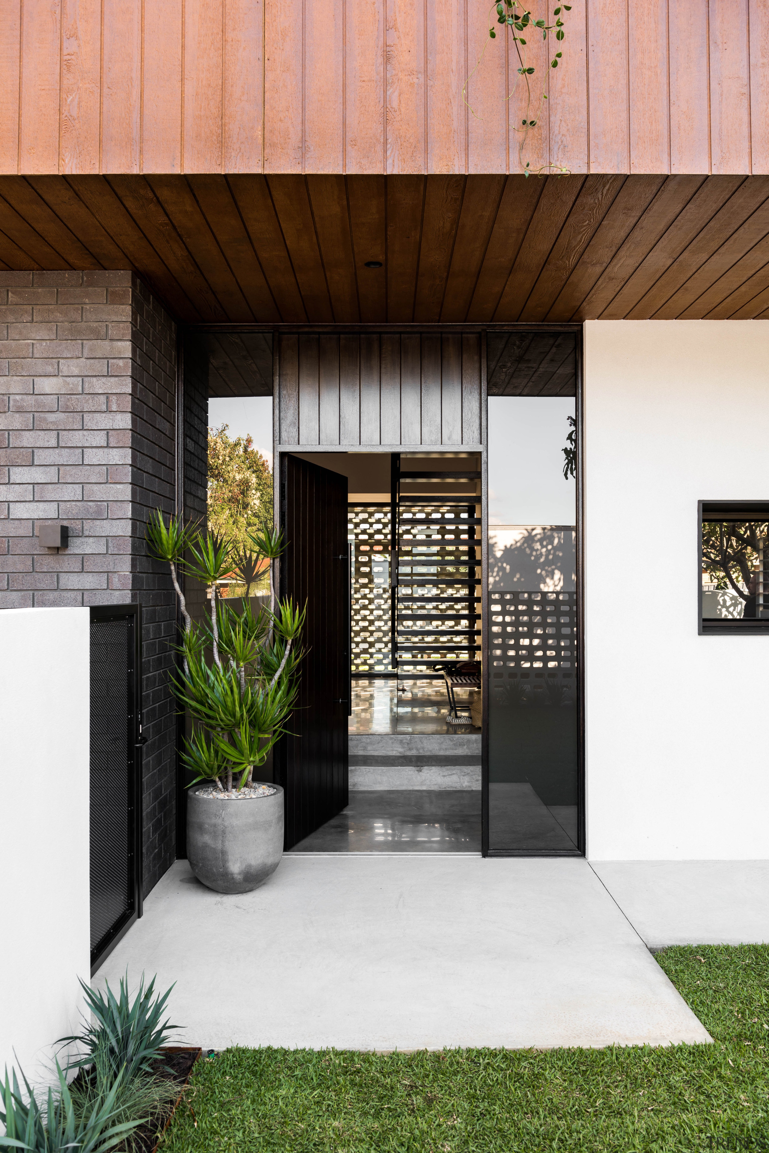 On entry to this home, guests look through architecture, entrance, facade, floor, flooring, grass, home, house, roof, Dalecki Design, Limitless Building