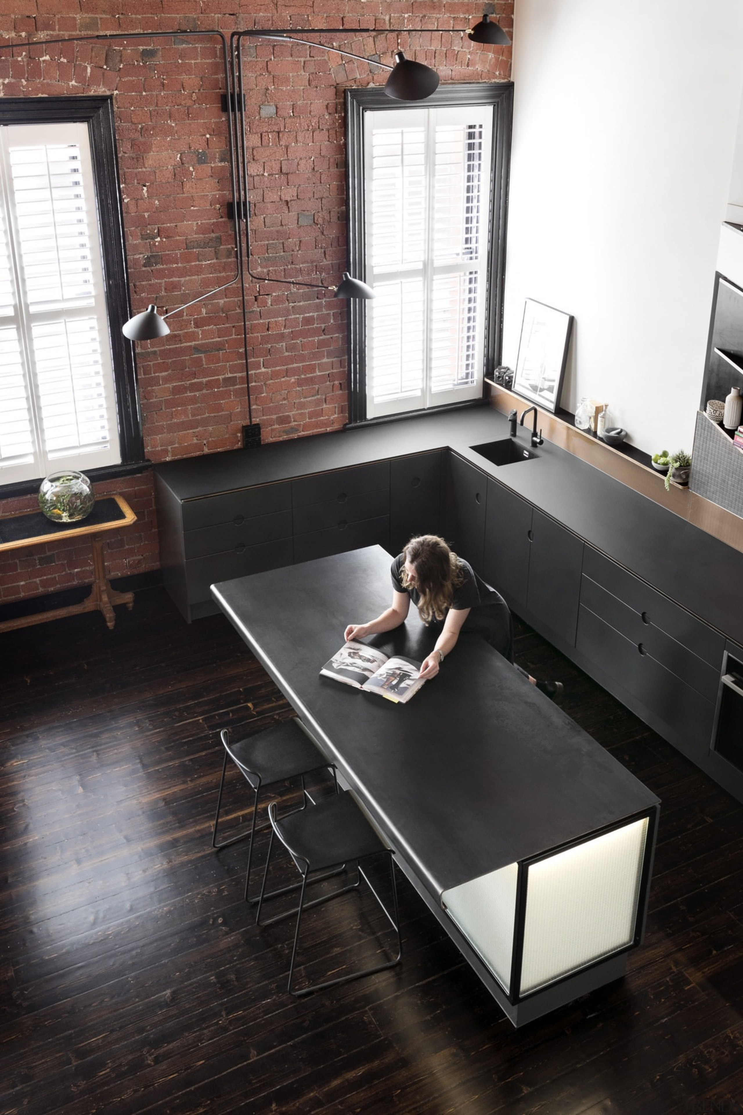 Ample space for entertaining and preparing meals - countertop, desk, floor, flooring, furniture, hardwood, interior design, living room, product design, room, table, wood, black, white