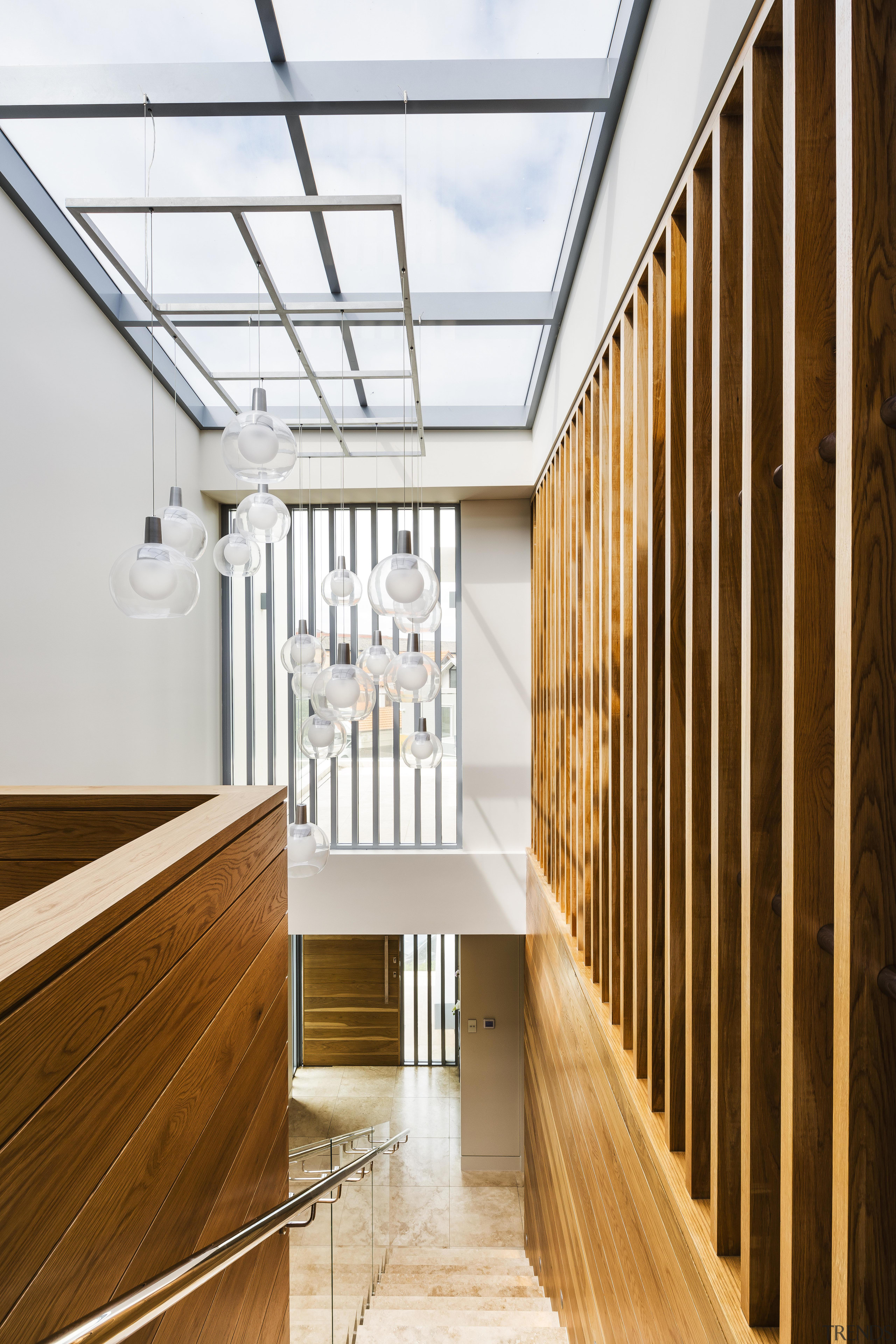 The double-height entry hall to this home includes architecture, handrail, house, interior design, stairs, stairway, wood, timber, entranceway, skylights, cantilevered stairway, Giles & Tribe Architects, Tida Awards
