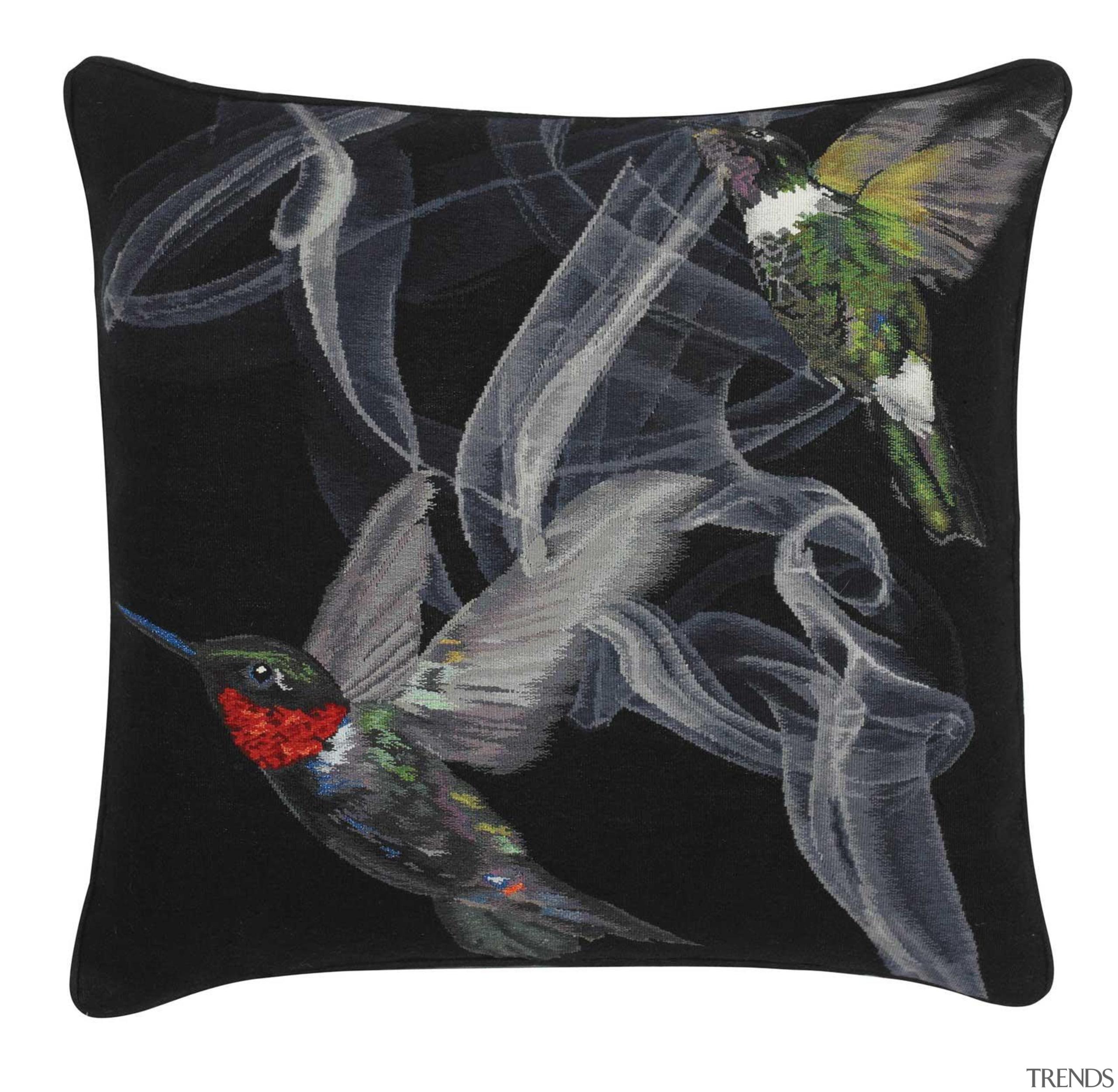 Jewel-like iridescent hummingbirds are hand woven in silk cushion, throw pillow, black, white