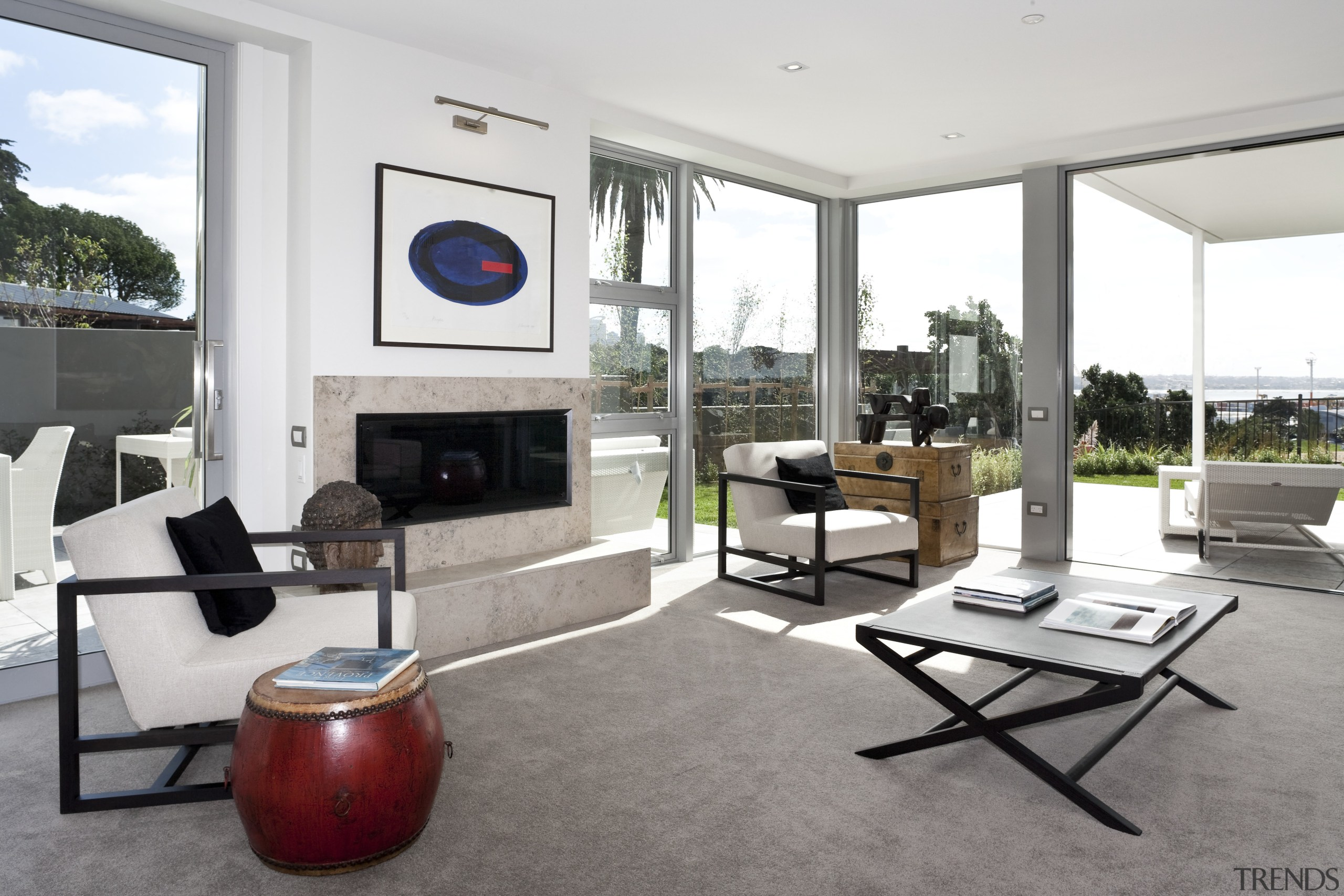 View of the open plan living area featuring interior design, living room, property, real estate, white, gray