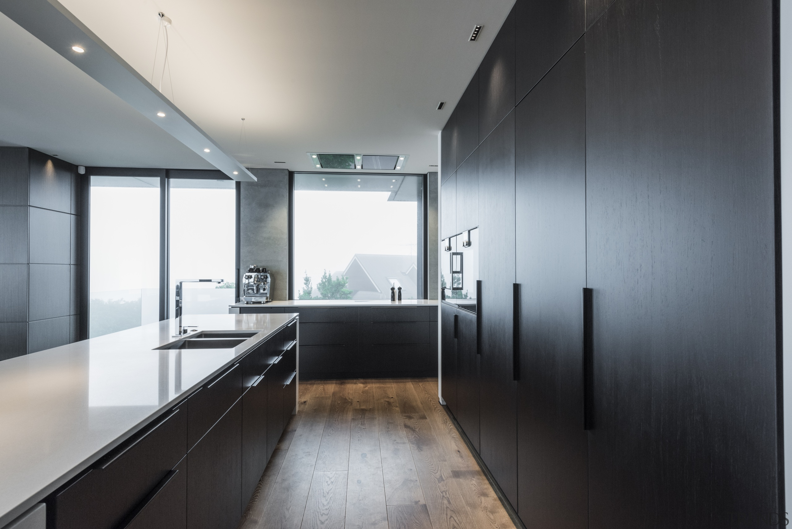 Understated cabinetry handles contribute to the pared-back look architecture, countertop, daylighting, house, interior design, kitchen, gray, black