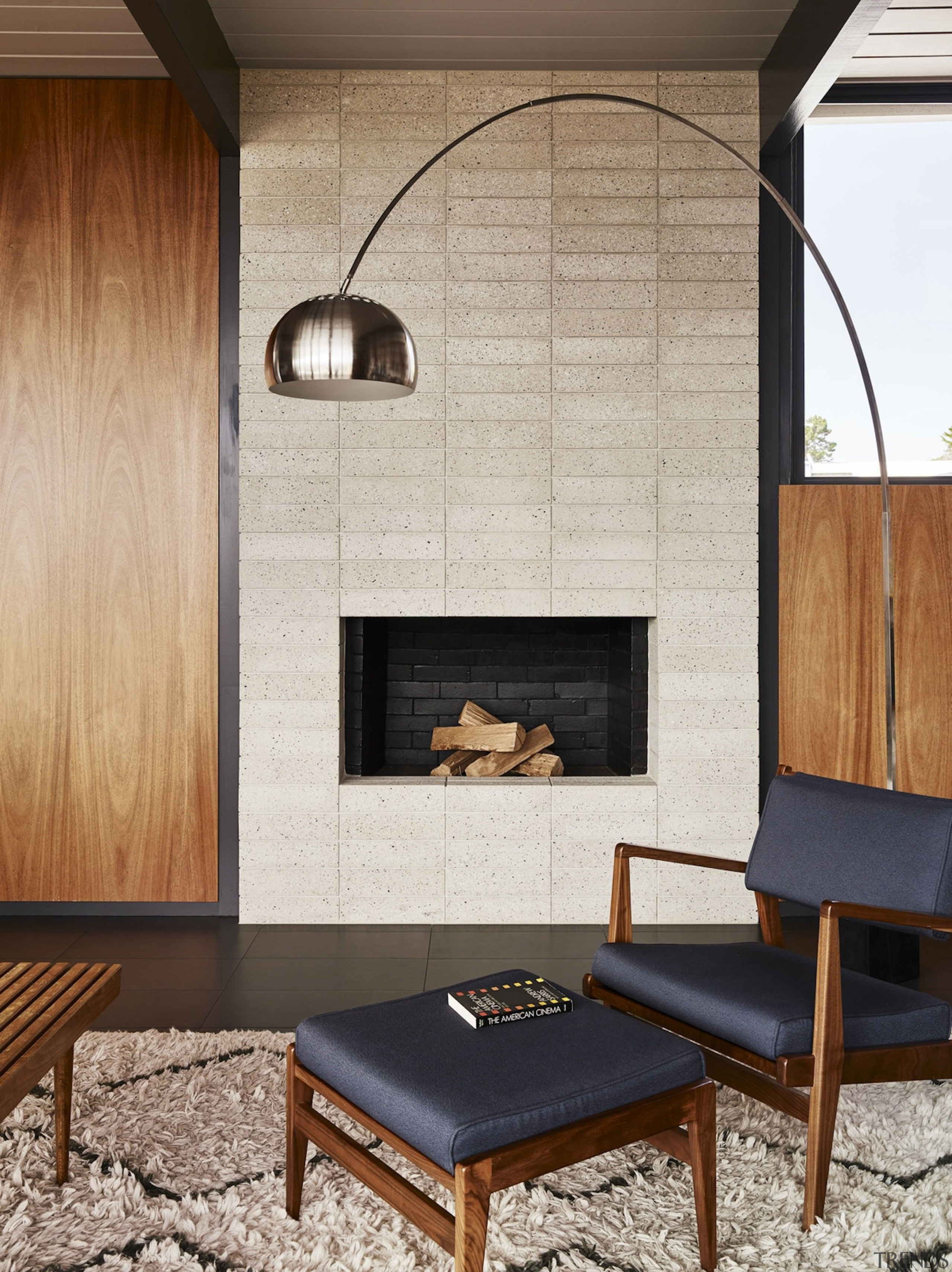 The fireplace sits tucked into the wall - architecture, ceiling, chair, fireplace, floor, flooring, furniture, hearth, interior design, living room, table, wall, gray