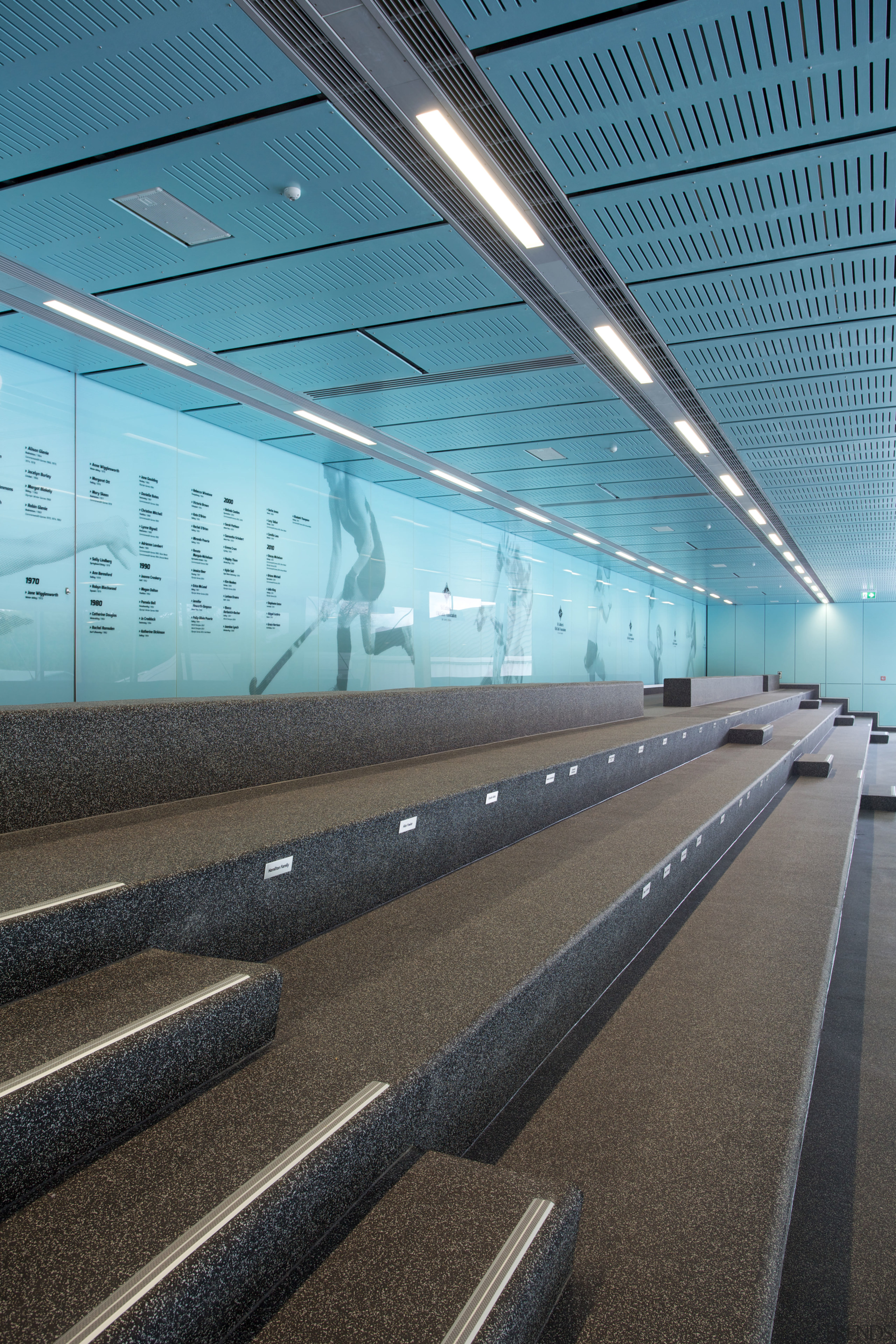 Spectator seating at the St Cuthberts Centennial Centre airport terminal, architecture, building, daylighting, fixed link, infrastructure, line, metropolitan area, reflection, sky, structure, teal, black
