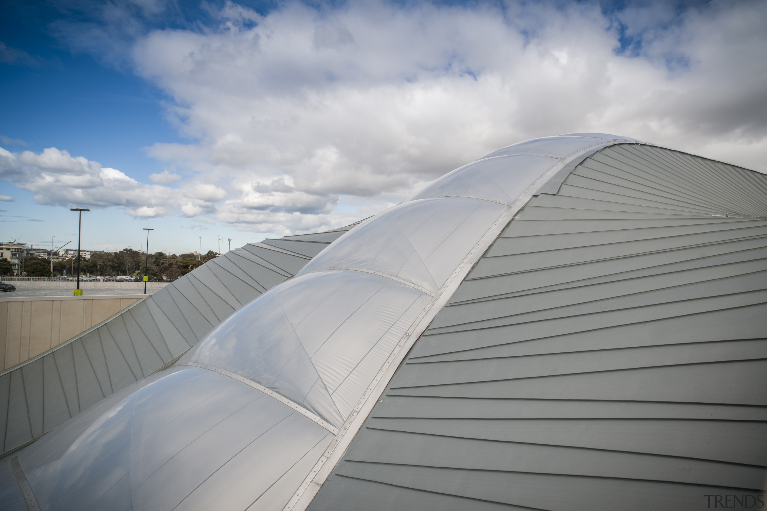 The roof was chosen in part for its architecture, atmosphere of earth, cloud, daylighting, daytime, line, roof, sky, structure, sunlight, gray