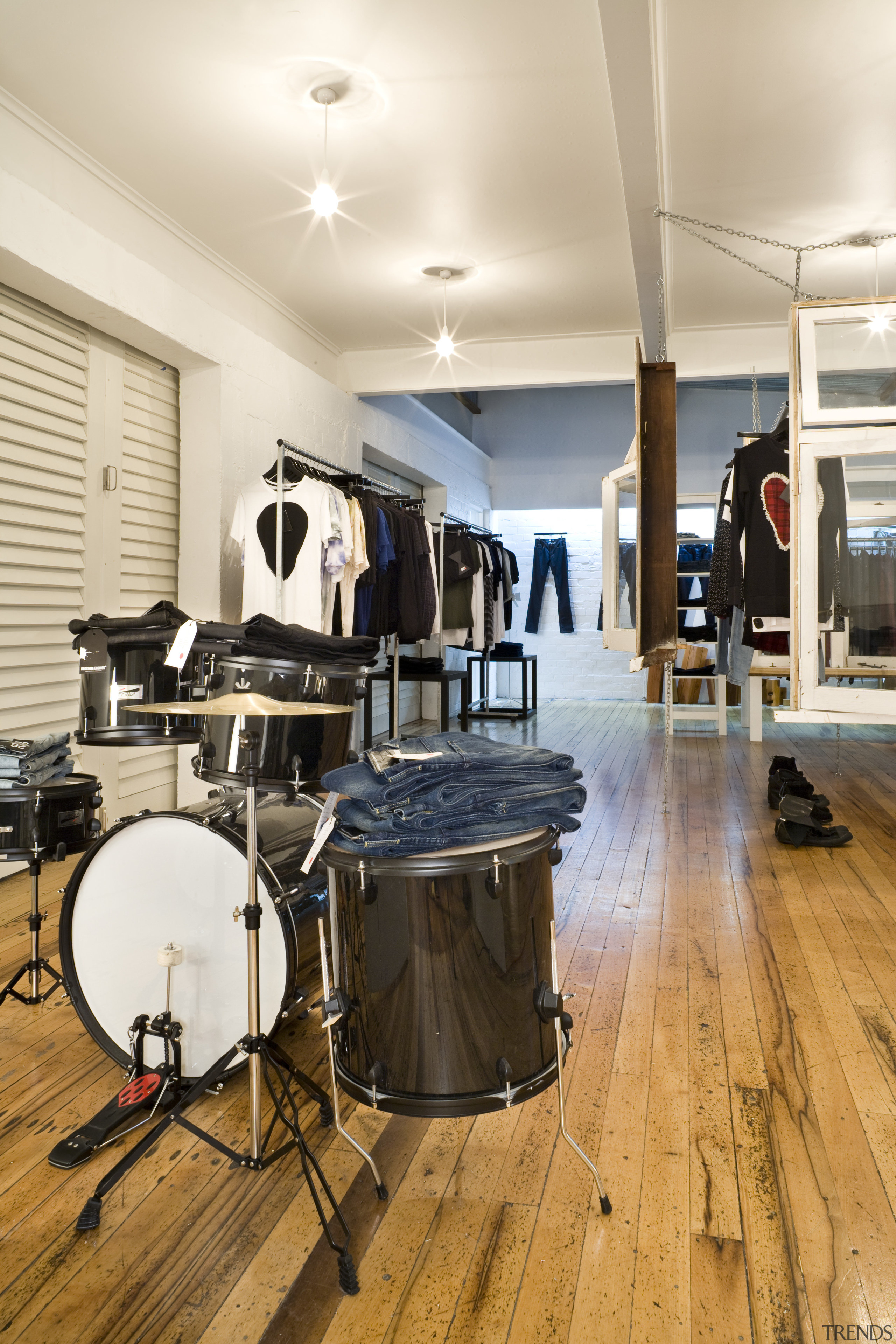 View of a drum kit which is used drum, drums, floor, flooring, hardwood, interior design, musical instrument, percussion, skin head percussion instrument, tom tom drum, wood flooring, white