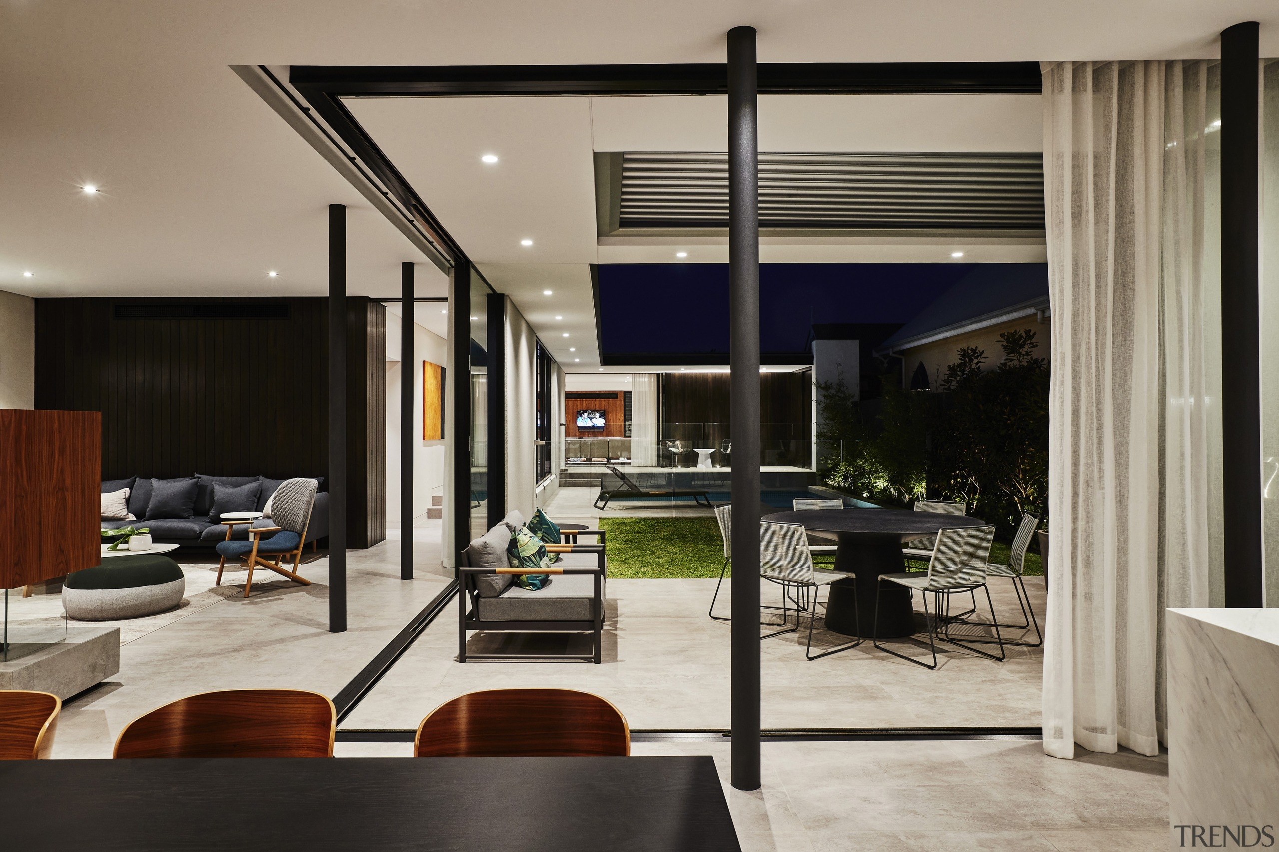 The outdoor living zone, pool included, is enclosed