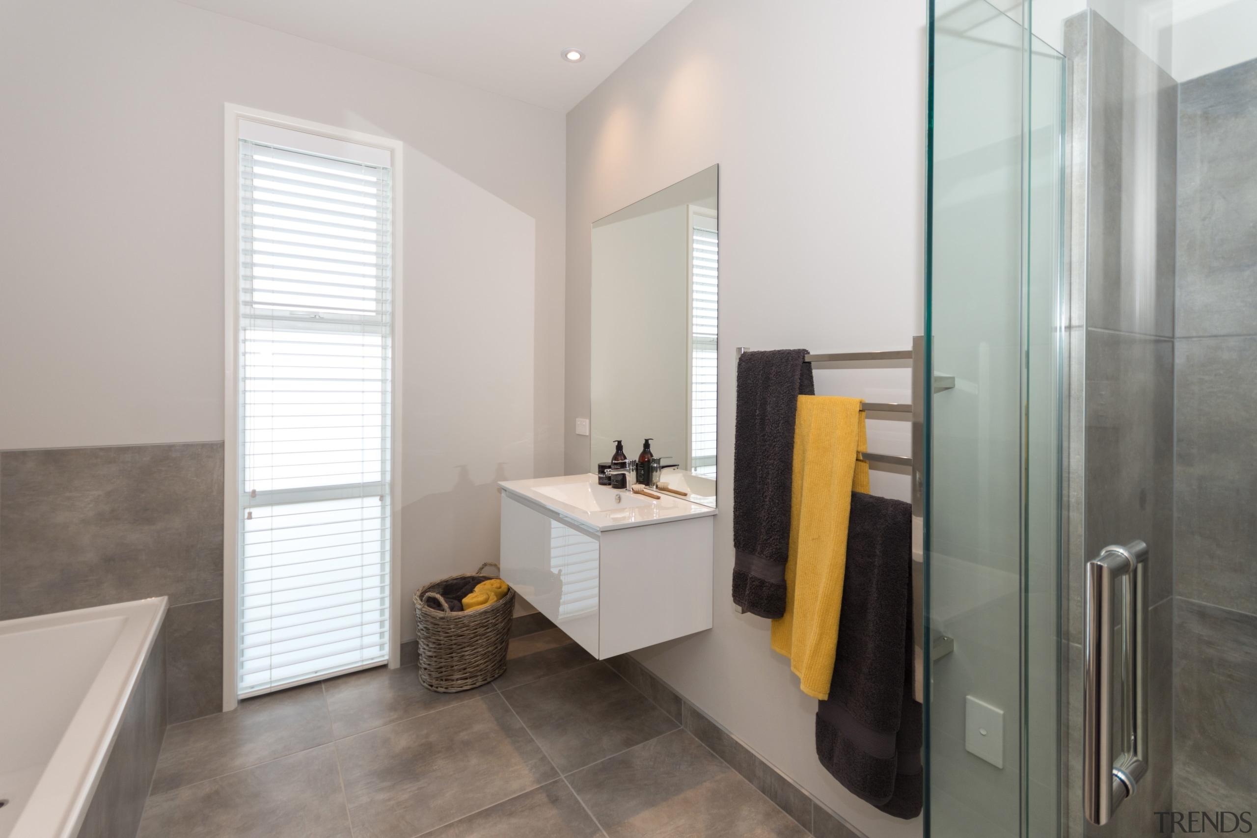 This family bathroom has a vanity with a bathroom, bathroom accessory, bathroom cabinet, floor, interior design, real estate, room, gray