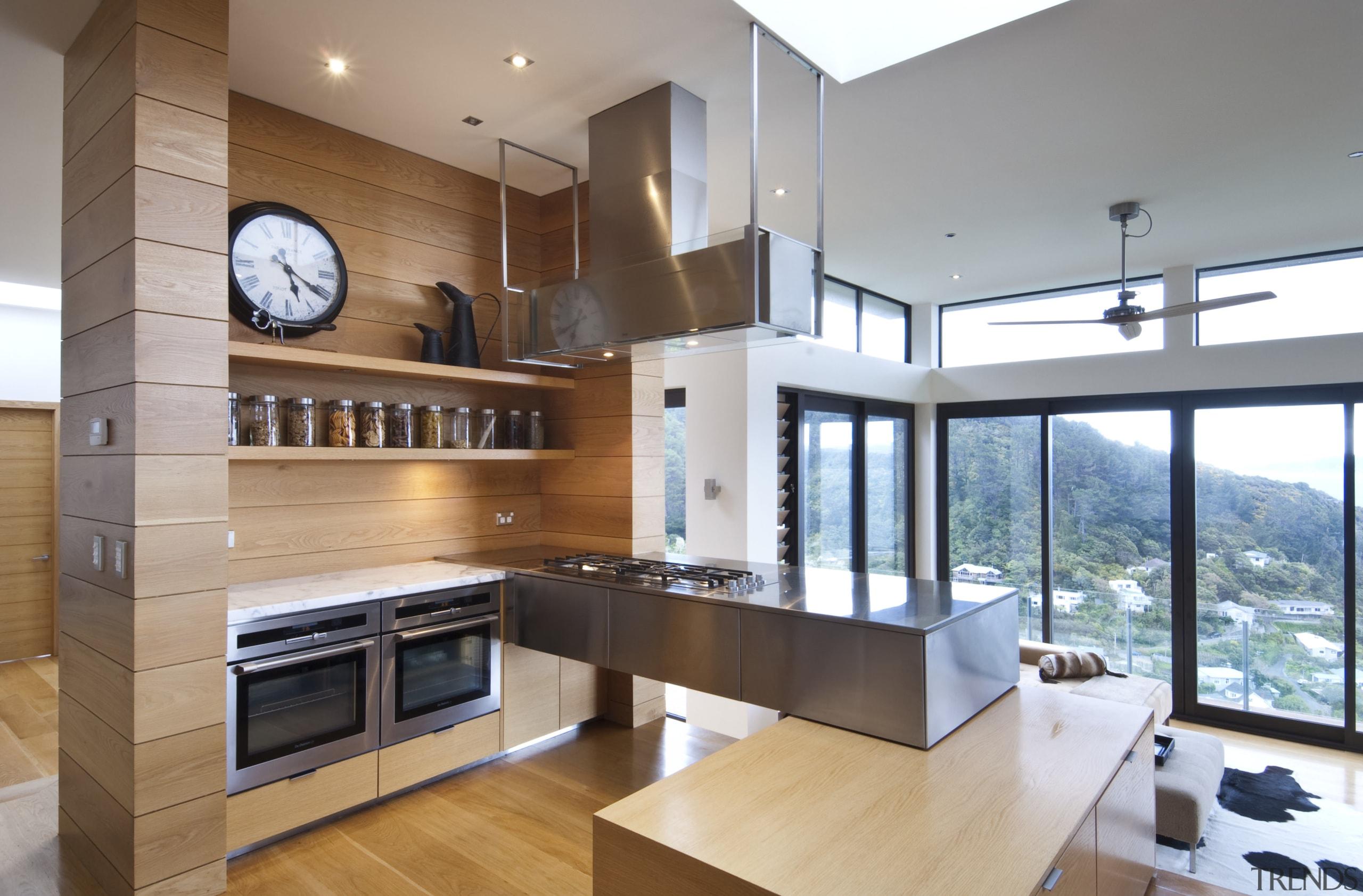 Raised floor kitchen. Stainless steel Binova cooktop. American countertop, cuisine classique, interior design, kitchen, real estate, gray