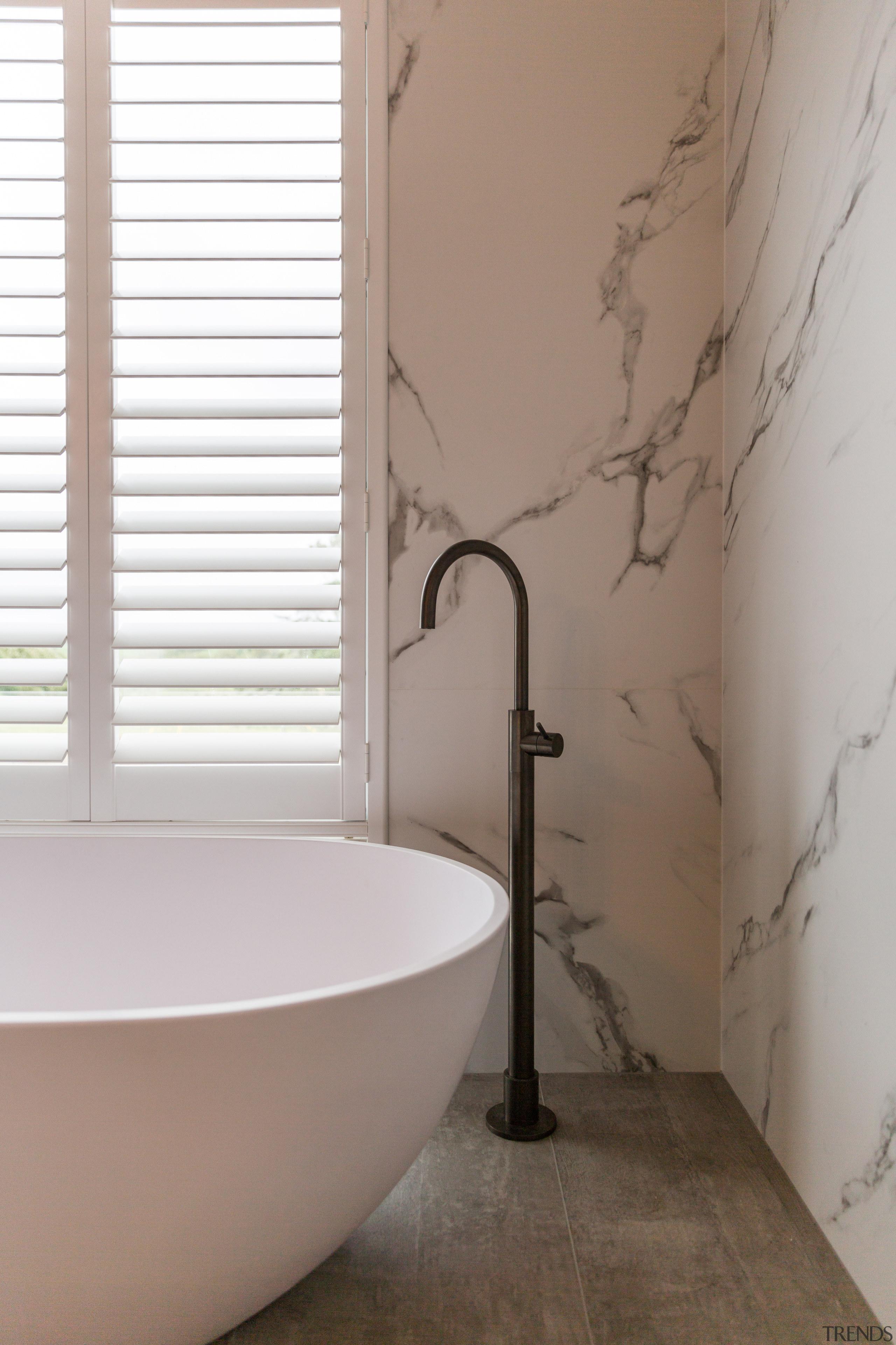 This light, open feel of the bathroom was bathroom, bidet, ceramic, floor, flooring, interior design, plumbing fixture, room, tap, tile, wall, gray, brown