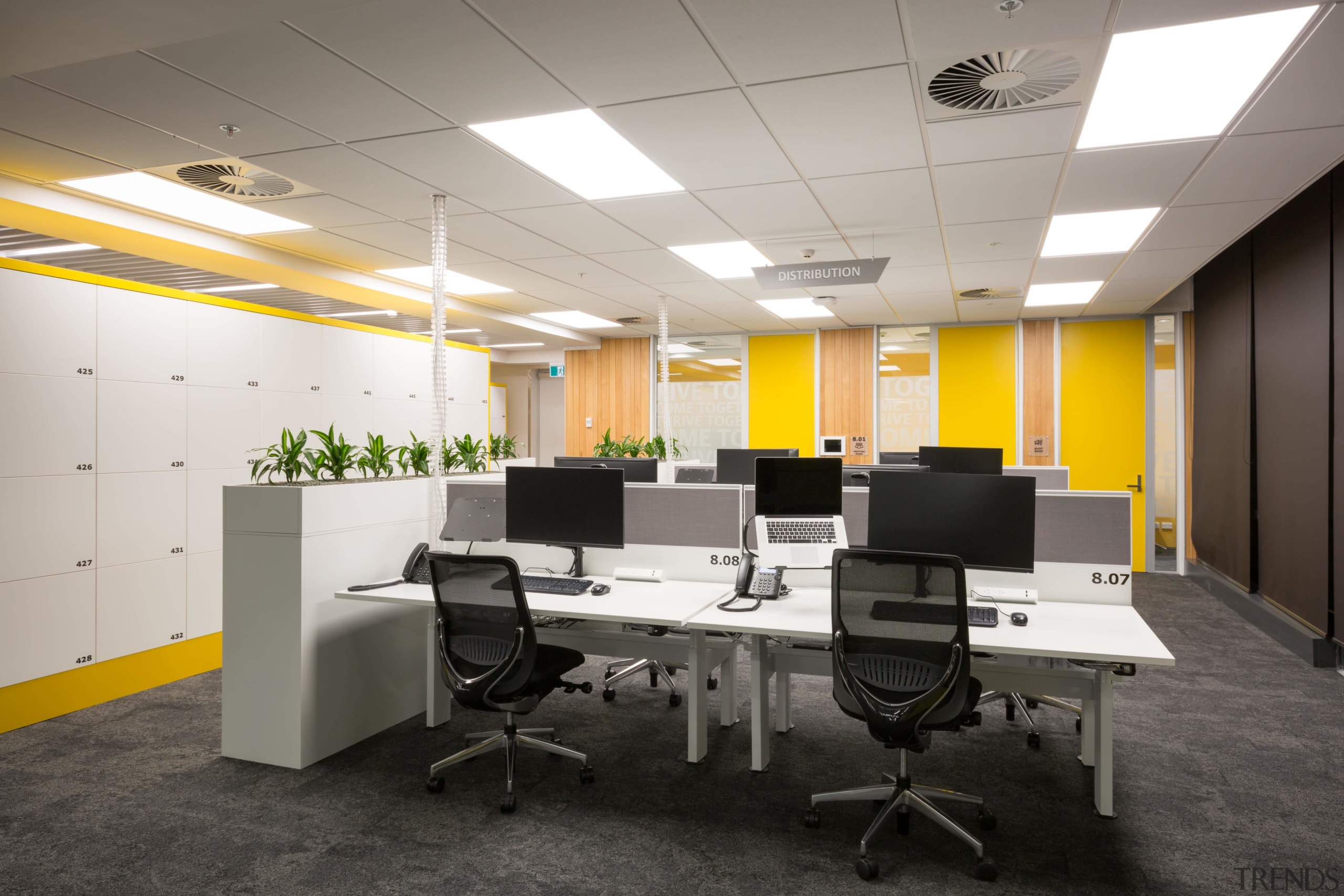 The locker surrounds and wall accents are yellow ceiling, conference hall, desk, furniture, interior design, office, product design, white, gray, black